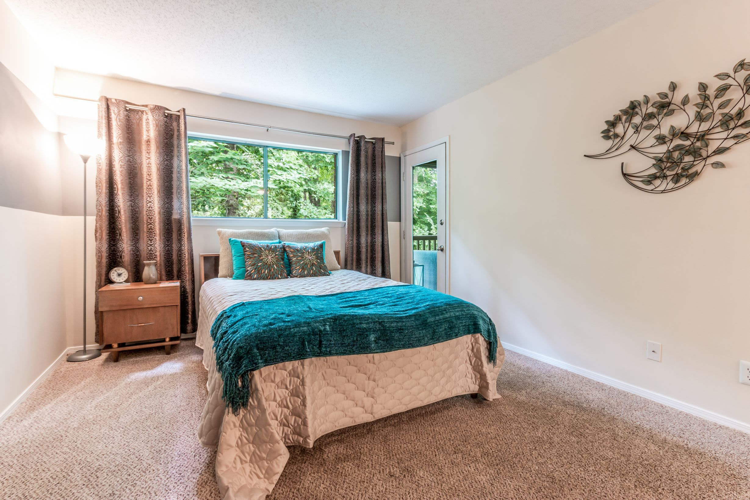 Bedroom with large window at Marquis at Perimeter Center in Atlanta, Georgia