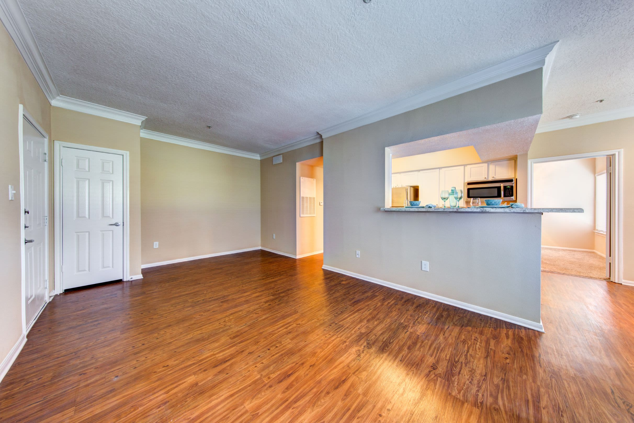 Living area with wood style floors at Marquis at Silverton in Cary, North Carolina