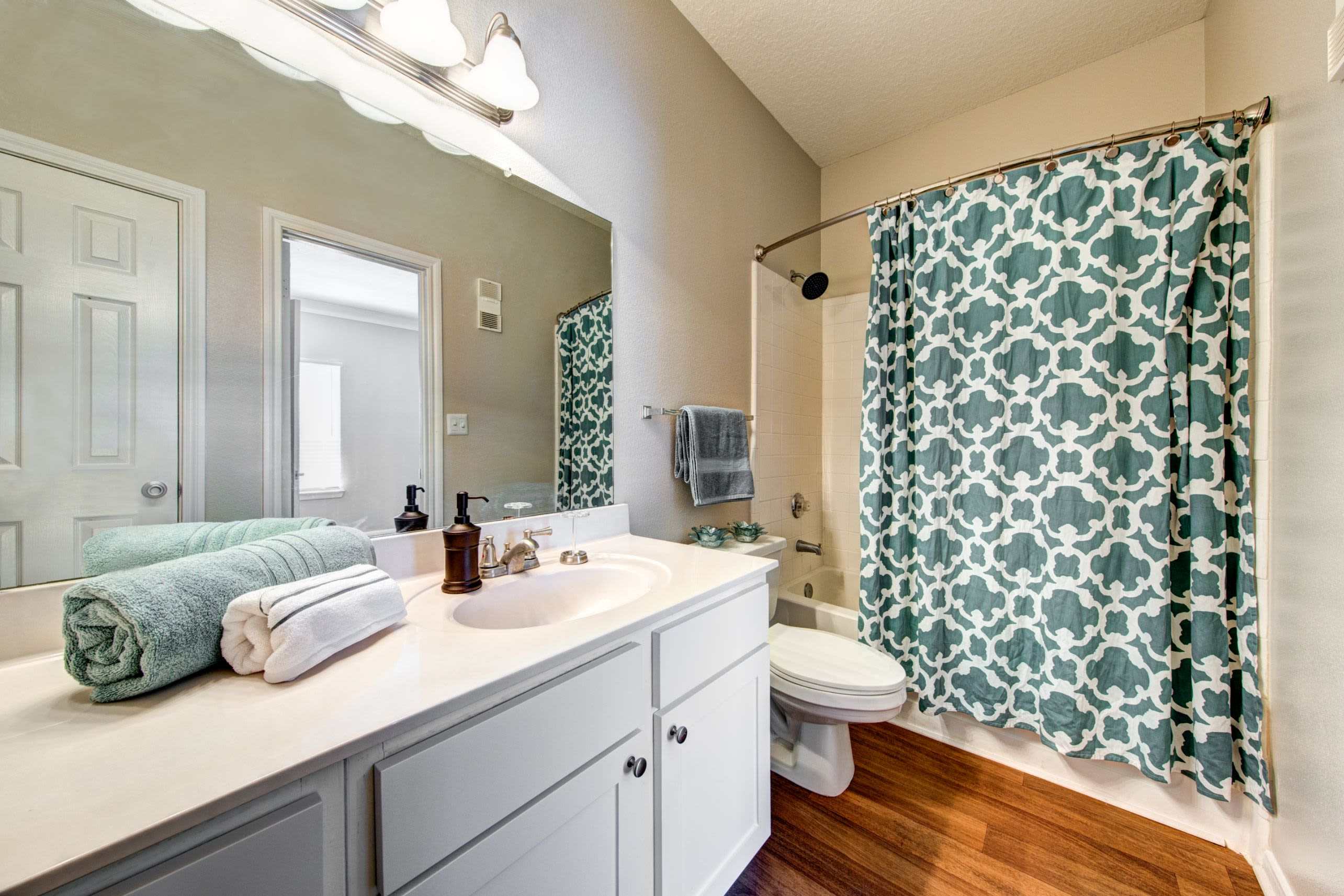 Spacious bathroom with white cabinets and counters at Marquis at Silverton in Cary, North Carolina