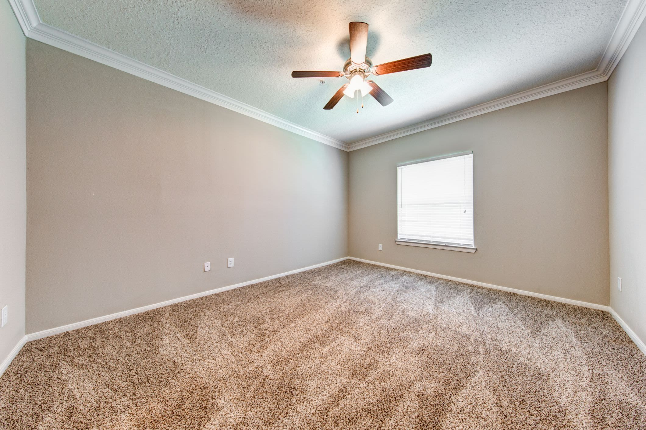 Bedroom with ceiling fan at Marquis at Silverton in Cary, North Carolina