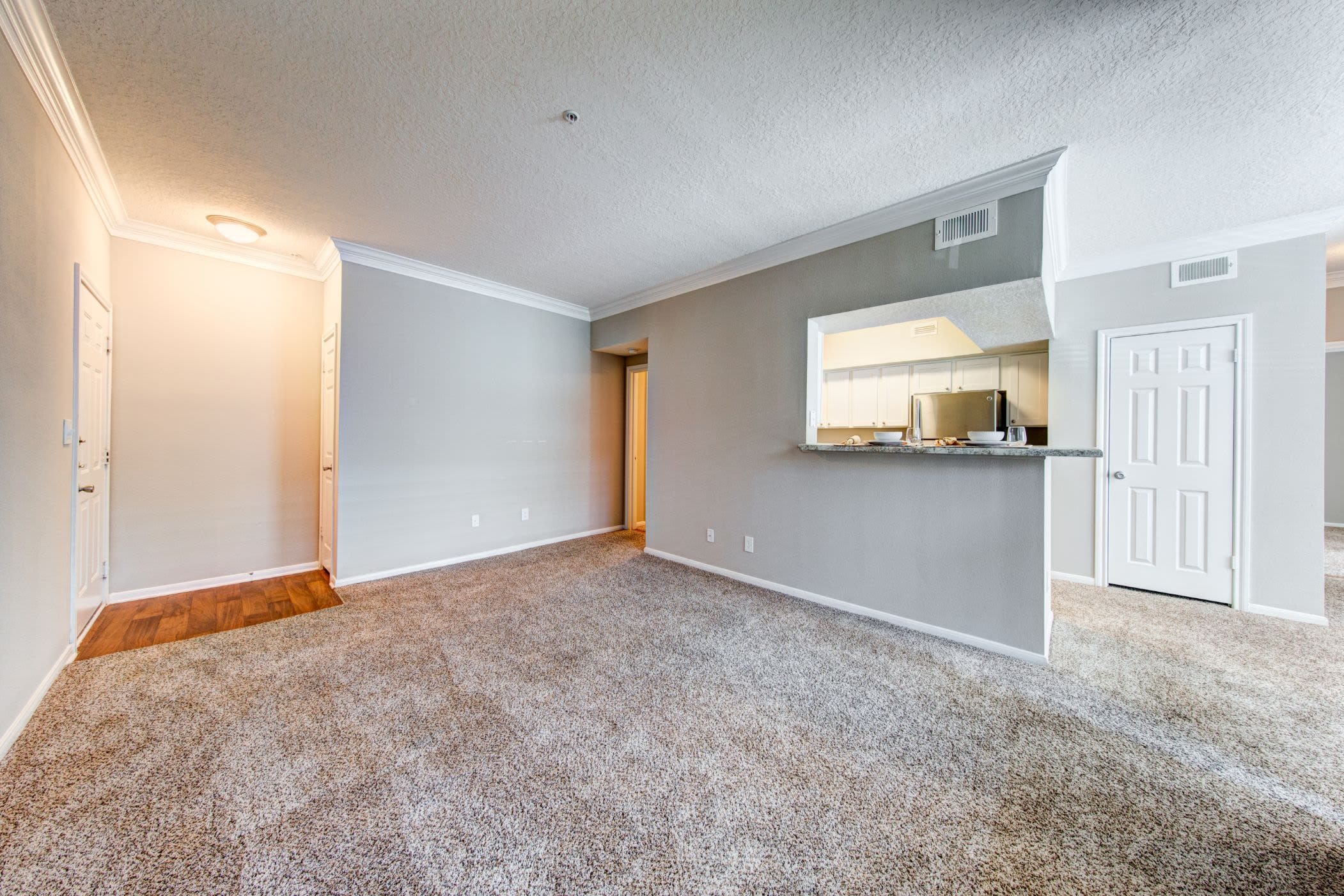Living area with carpet floors at Marquis at Silverton in Cary, North Carolina
