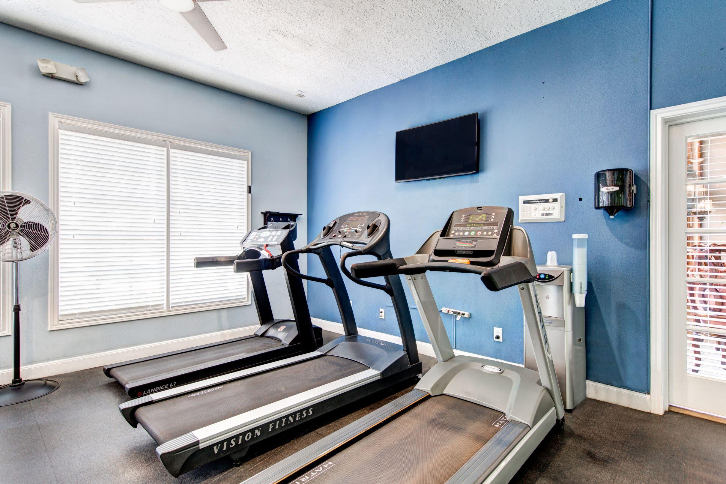 Row of treadmills with a TV at Marquis at Silverton in Cary, North Carolina