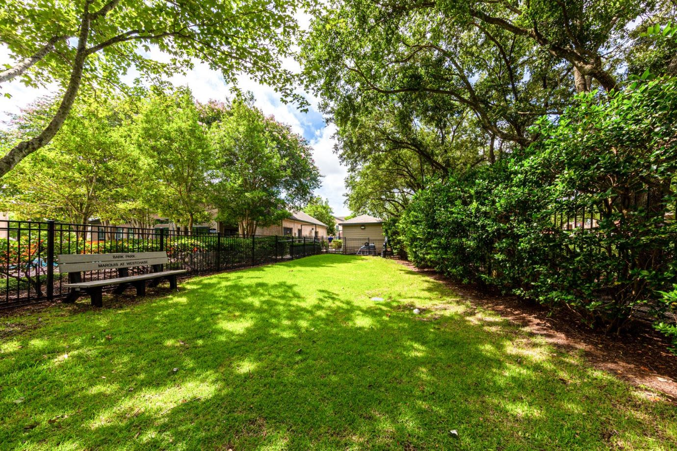 Fenced lawn at Marquis at Westchase in Houston, Texas