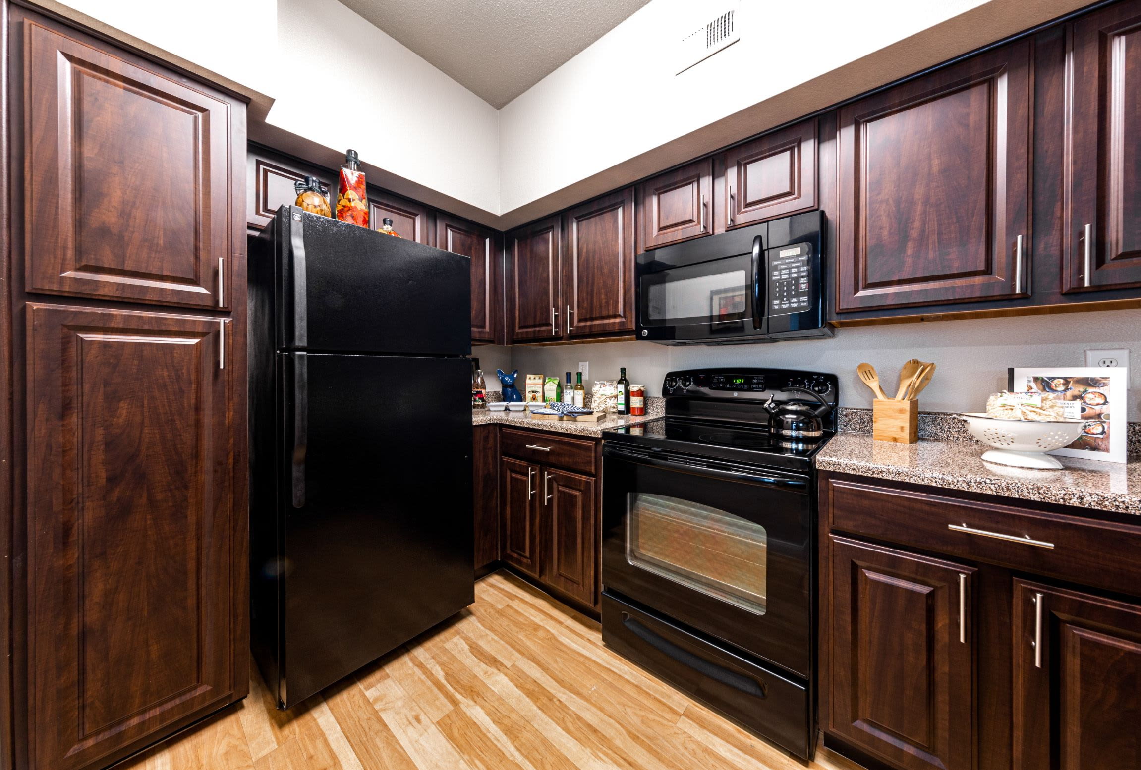 Kitchen with black appliances at Marquis at Westchase in Houston, Texas
