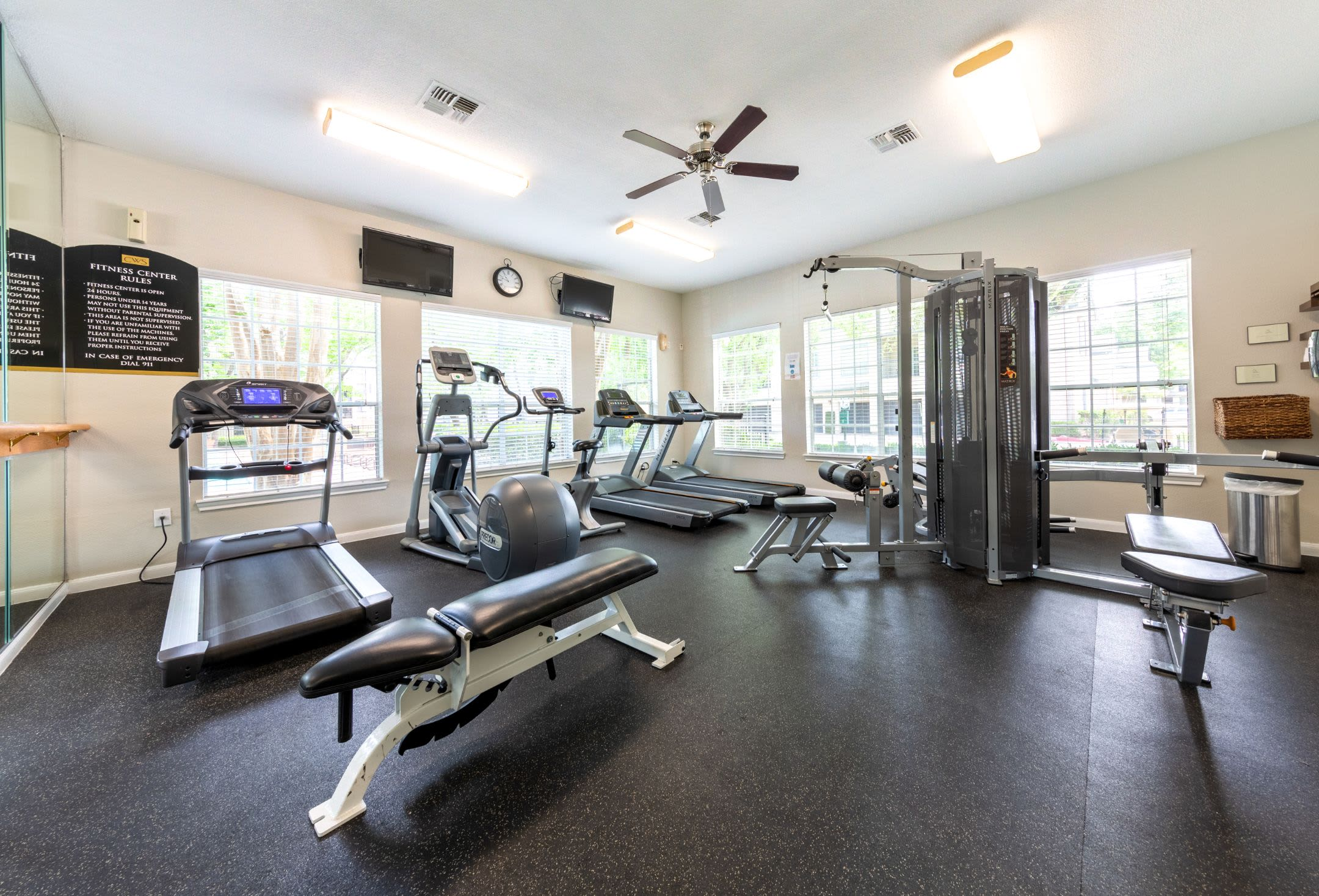 Fitness center with cardio and weight machines at Marquis at Westchase in Houston, Texas