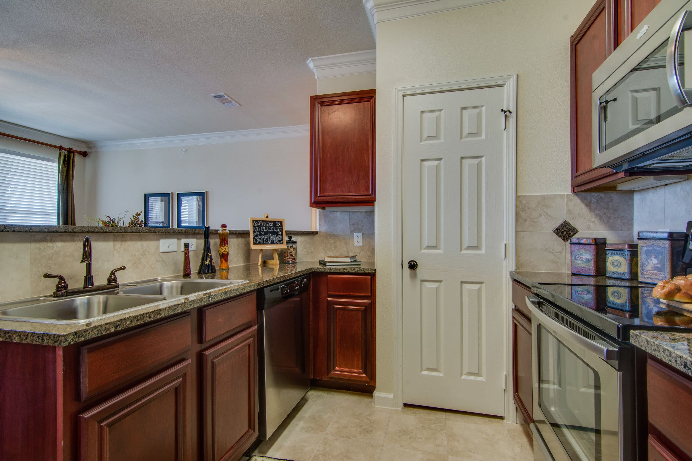 Kitchen with modern appliances at Marquis Rockwall in Rockwall, Texas
