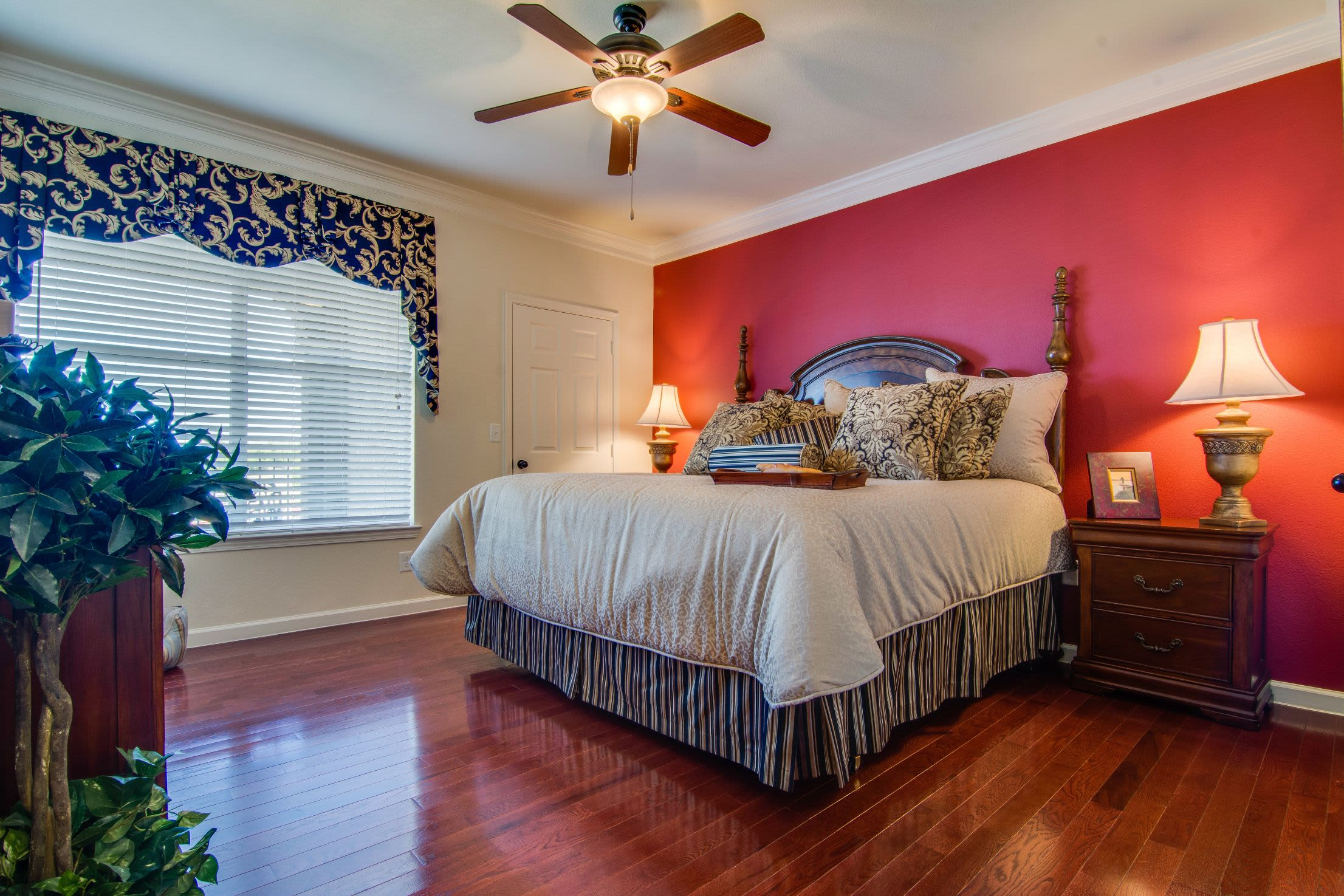 Bedroom with wood style floors at Marquis Rockwall in Rockwall, Texas