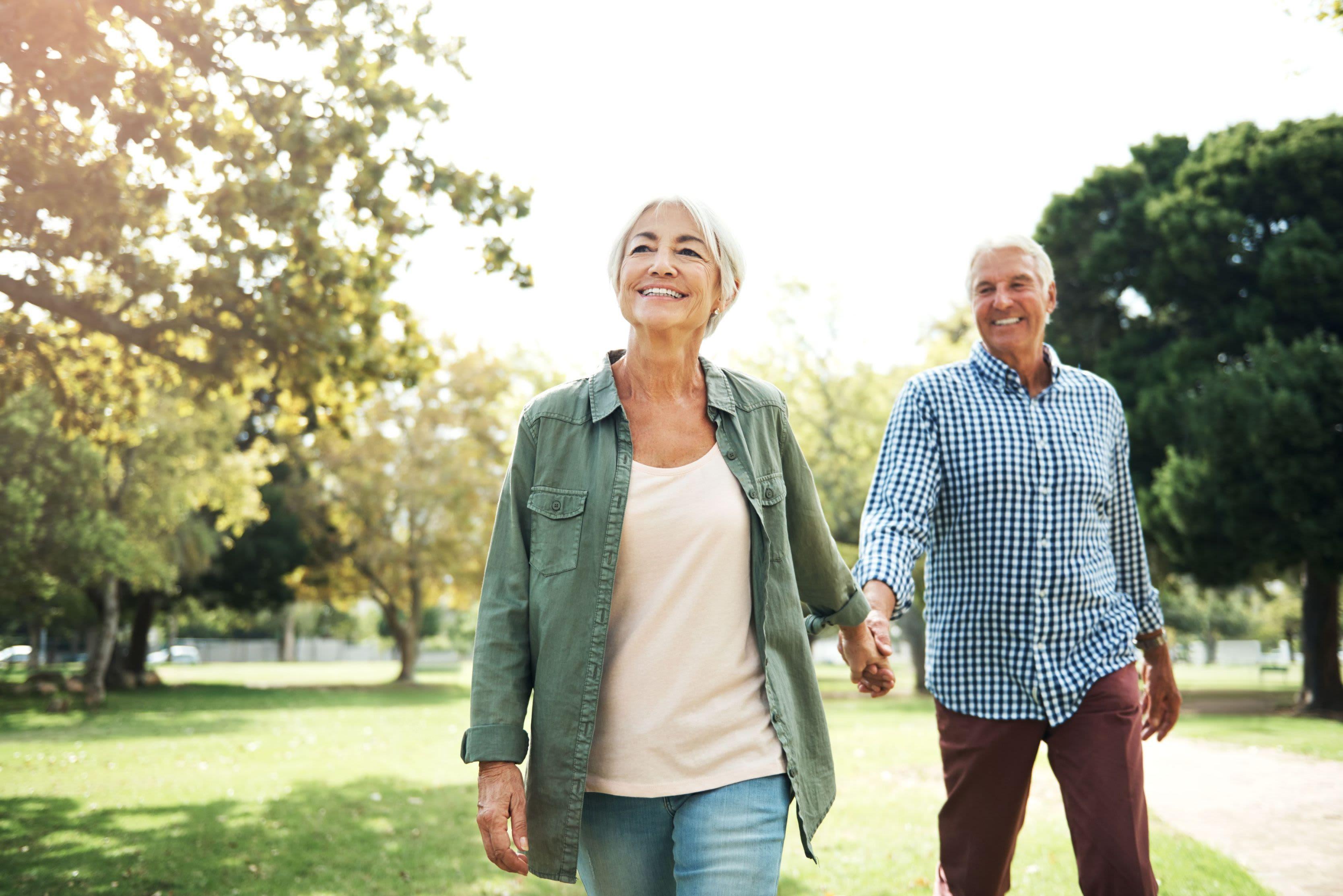Residents taking a walk in a park near Marquis Rockwall in Rockwall, Texas