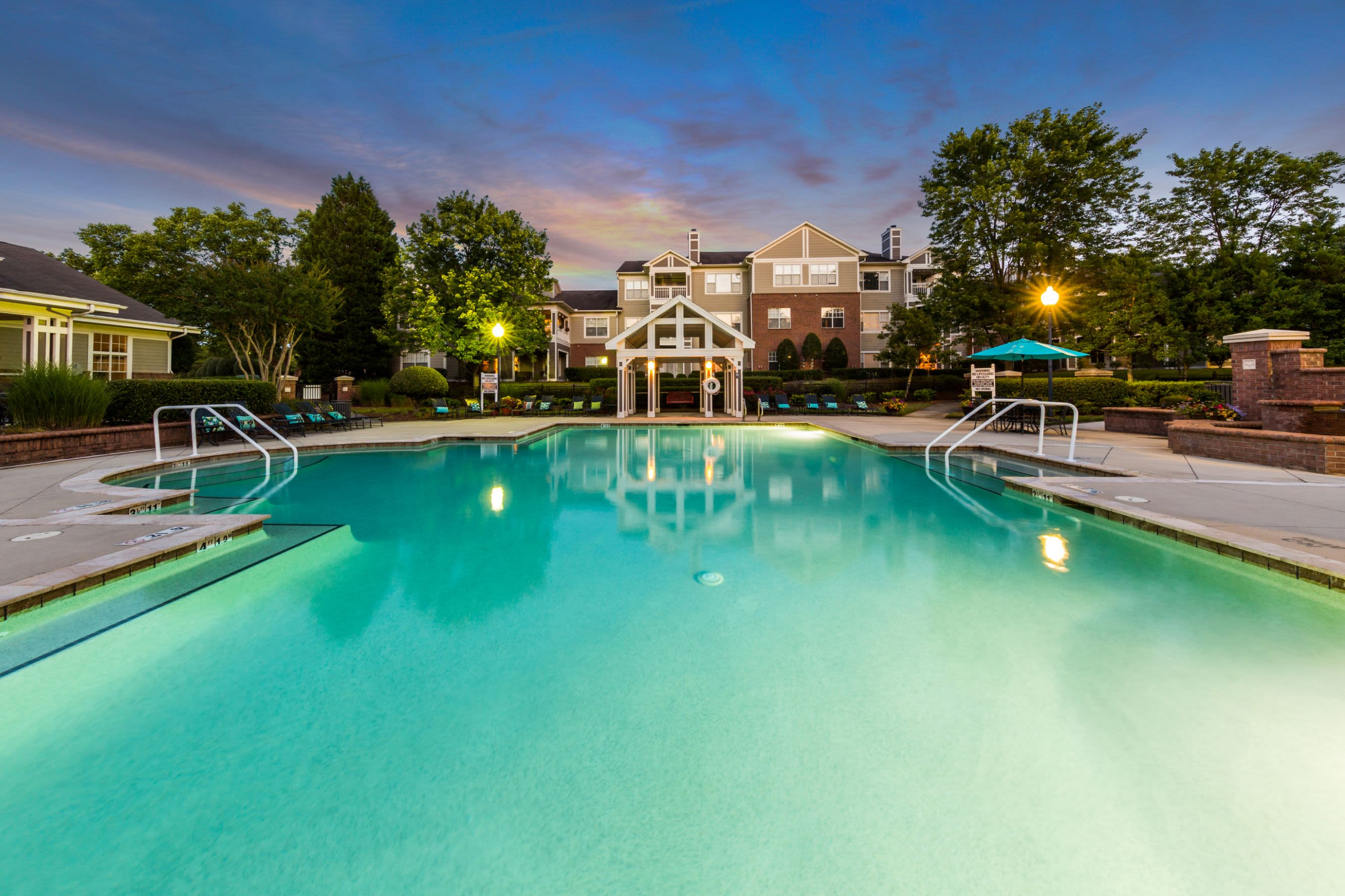Large swimming pool at dusk The Preserve at Ballantyne Commons in Charlotte, North Carolina