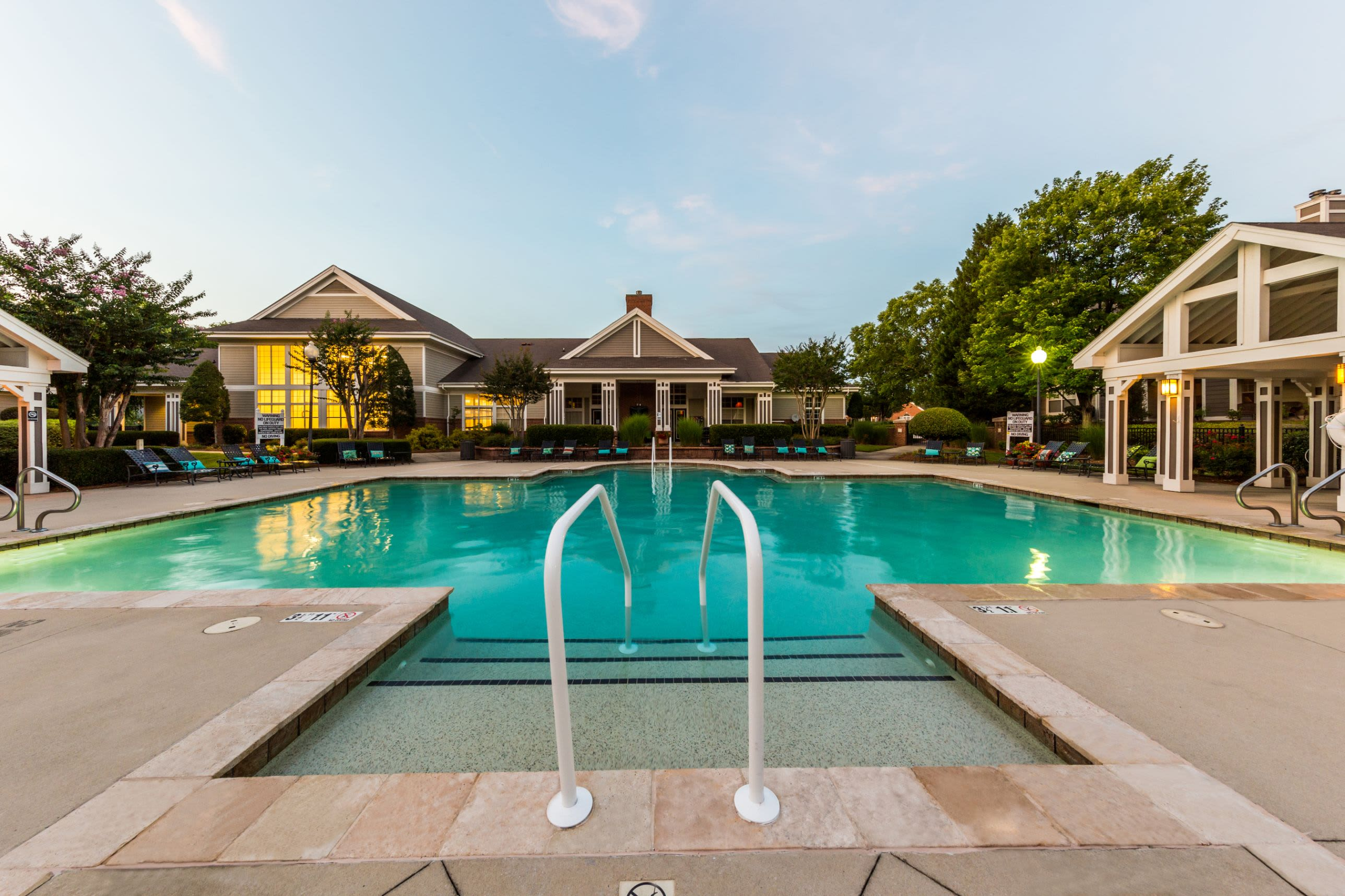 Swimming pool with hand rail at The Preserve at Ballantyne Commons in Charlotte, North Carolina