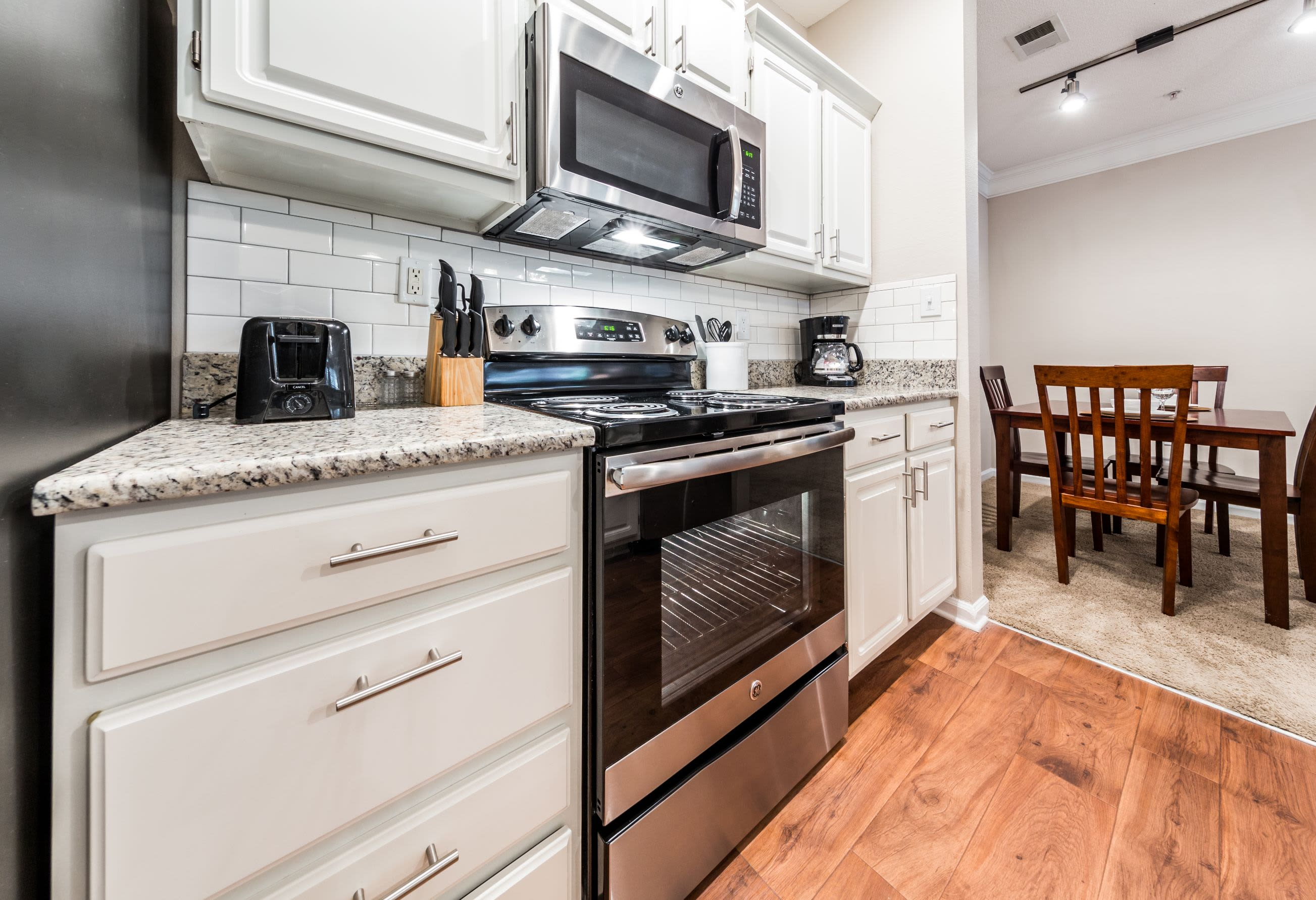Kitchen with wood style floors at The Preserve at Ballantyne Commons in Charlotte, North Carolina
