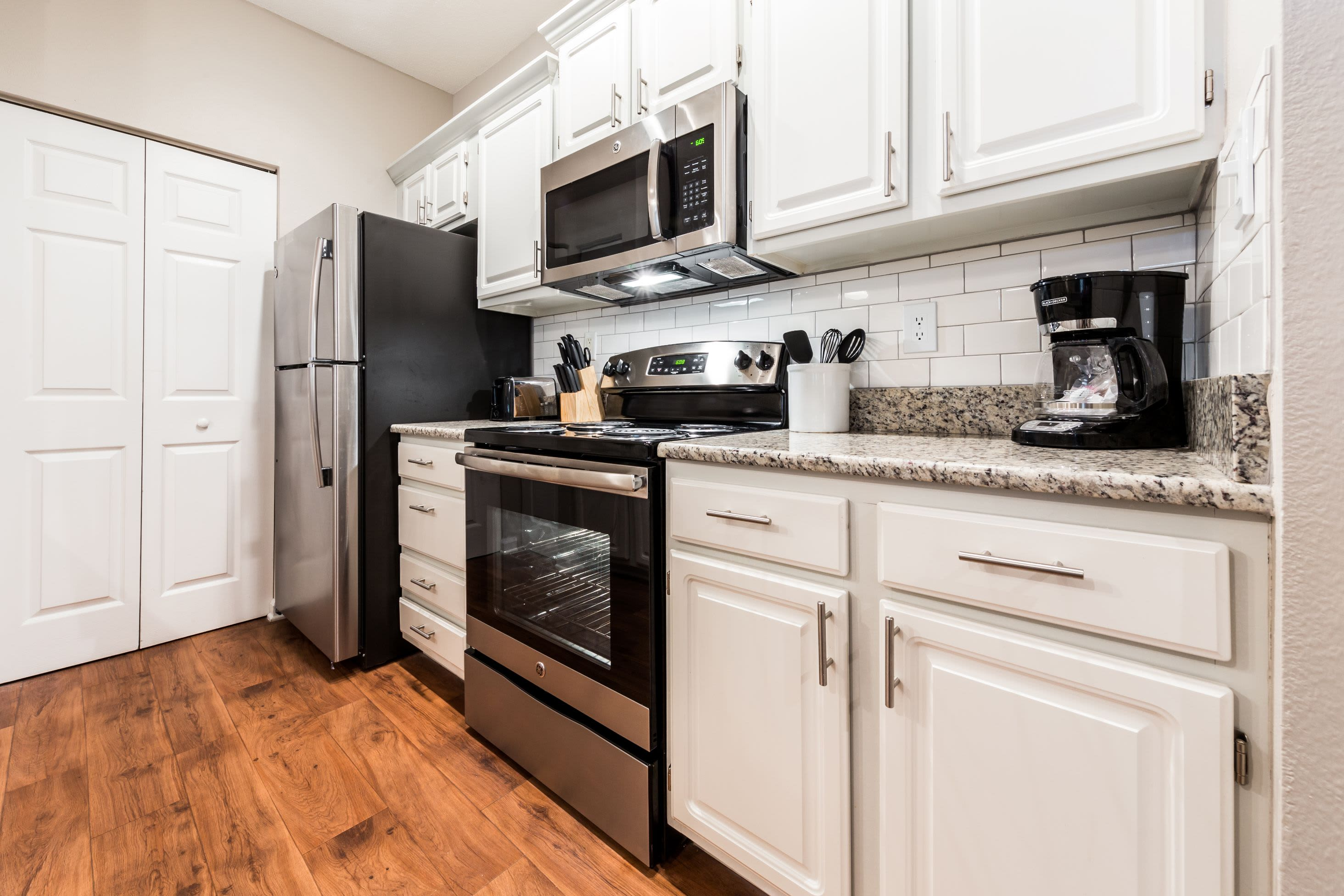 Modern kitchen with white cabinets at The Preserve at Ballantyne Commons in Charlotte, North Carolina