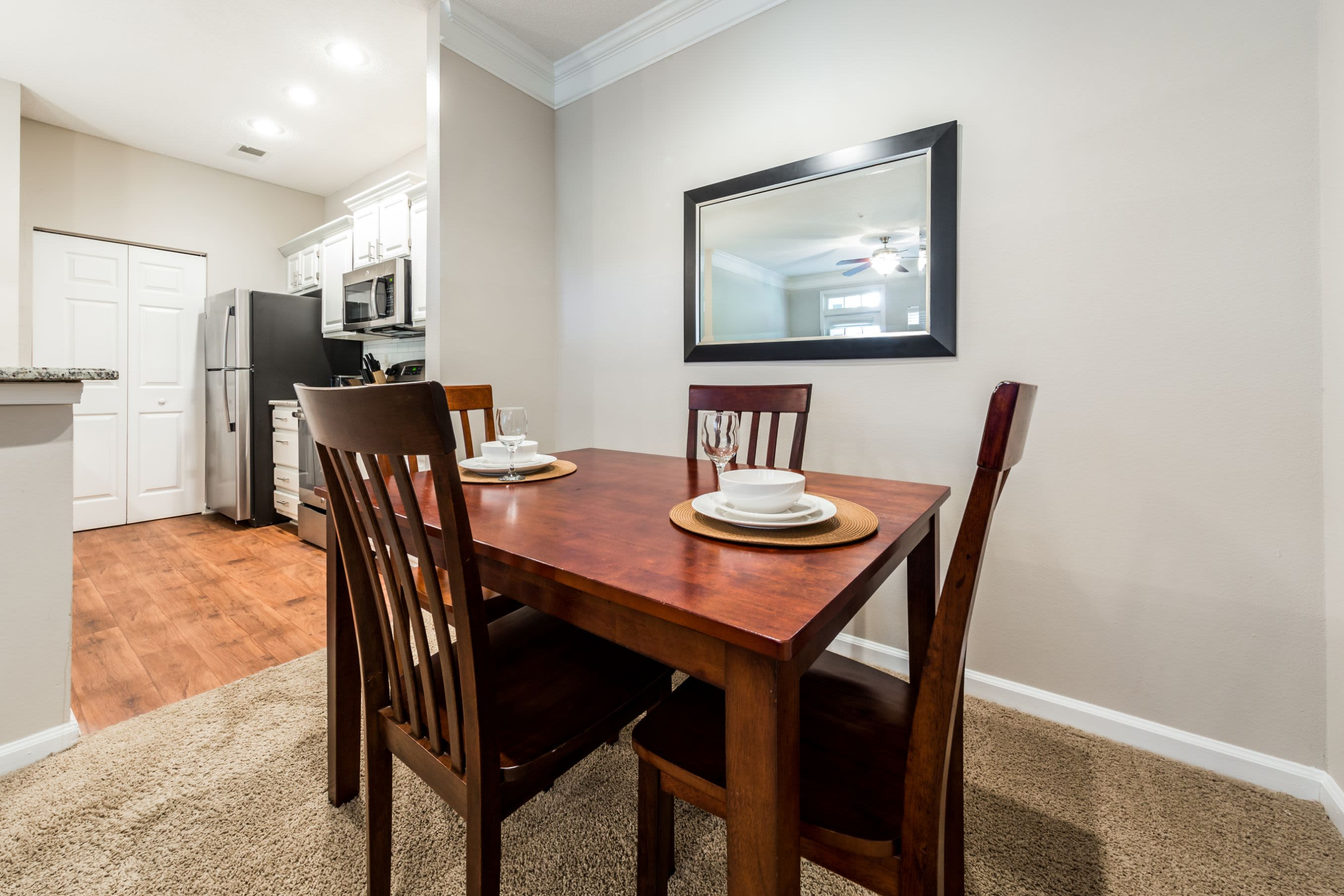 Dining area with carpeted floors at The Preserve at Ballantyne Commons in Charlotte, North Carolina