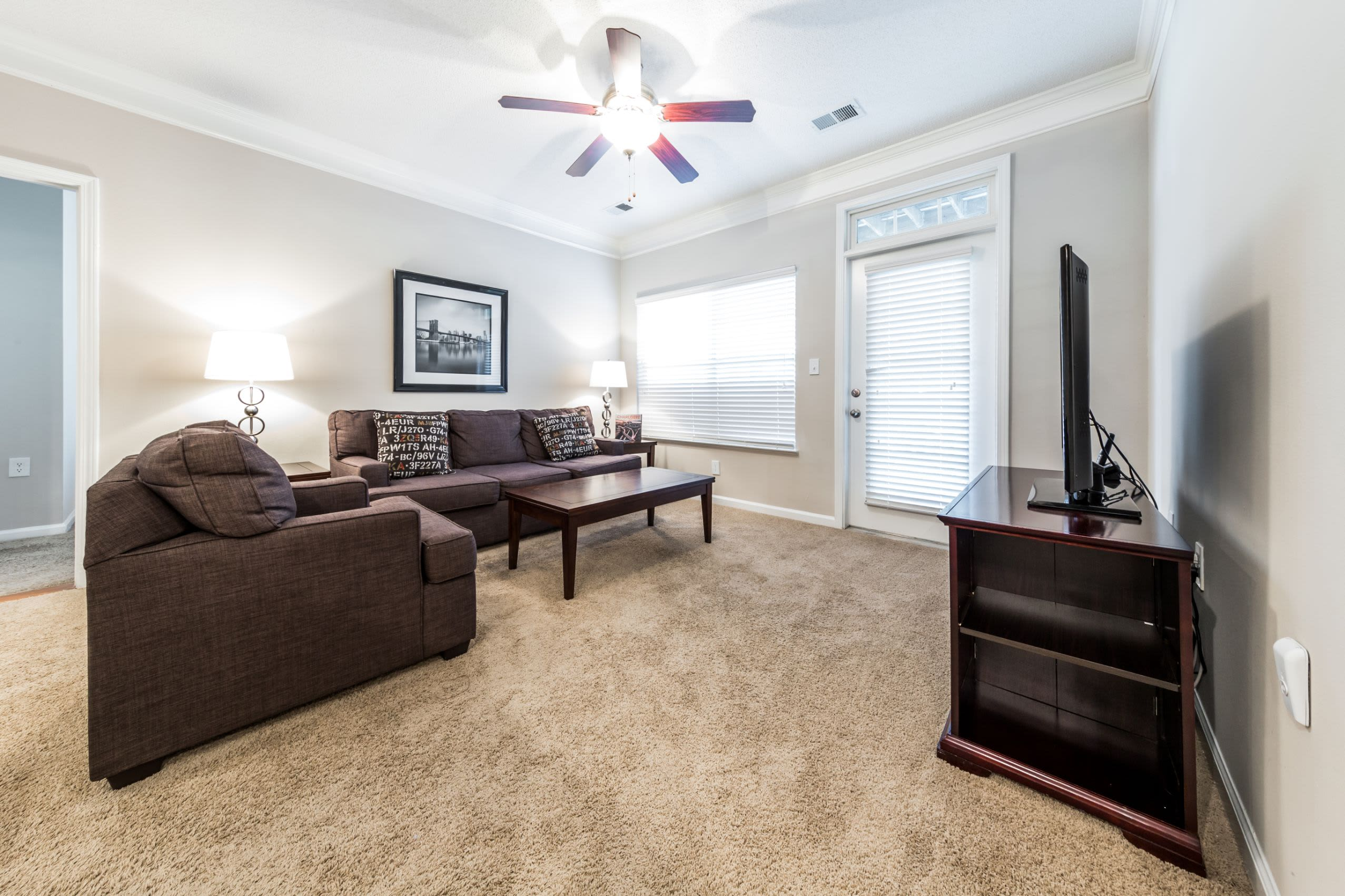 Living area with ceiling fan at The Preserve at Ballantyne Commons in Charlotte, North Carolina