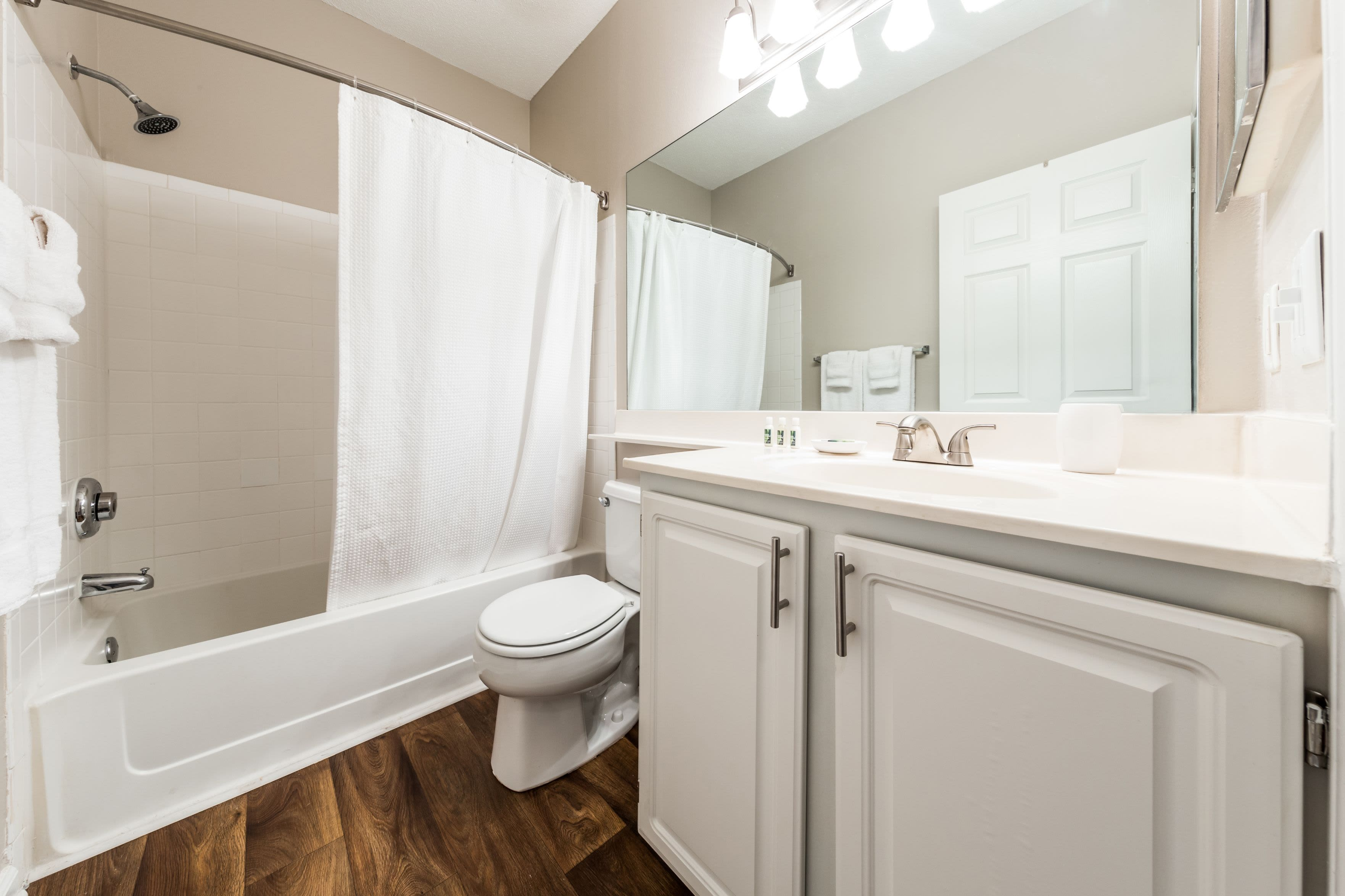 Bathroom with white cabinets and counters at The Preserve at Ballantyne Commons in Charlotte, North Carolina