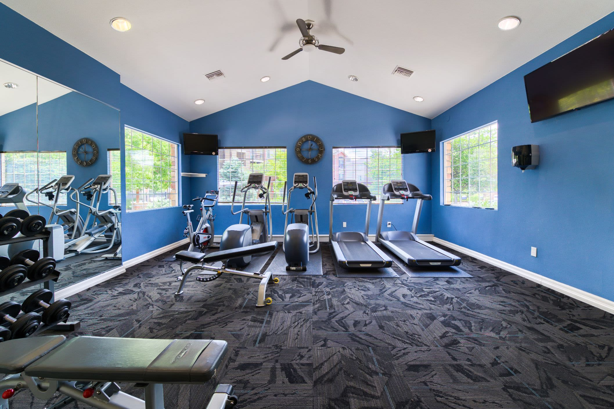 Treadmills in the fitness center at Whisper Creek Apartment Homes in Lakewood, Colorado