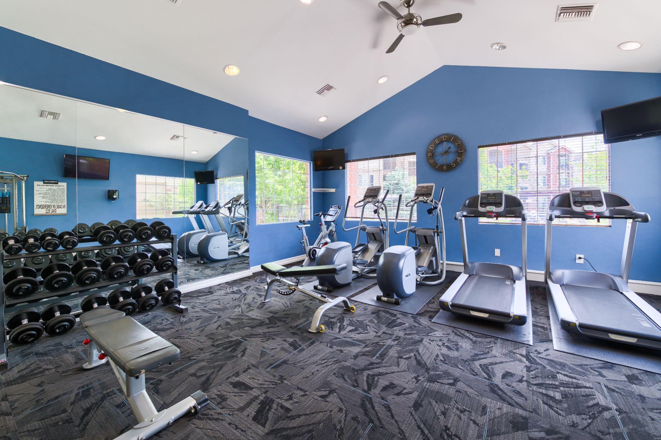 Fitness center with weights and cardio machine at Whisper Creek Apartment Homes in Lakewood, Colorado