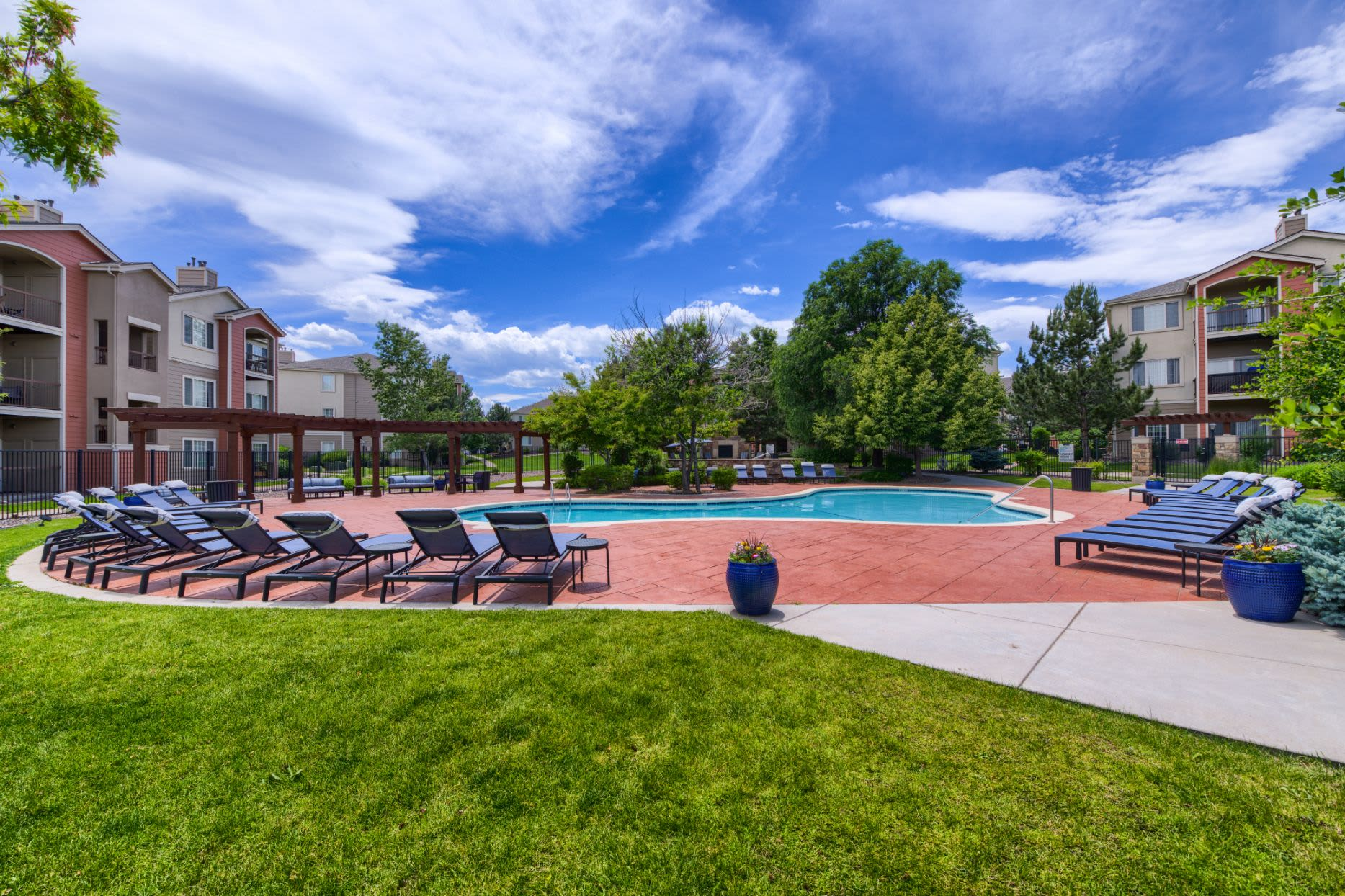 Sun chairs around the pool at Whisper Creek Apartment Homes in Lakewood, Colorado