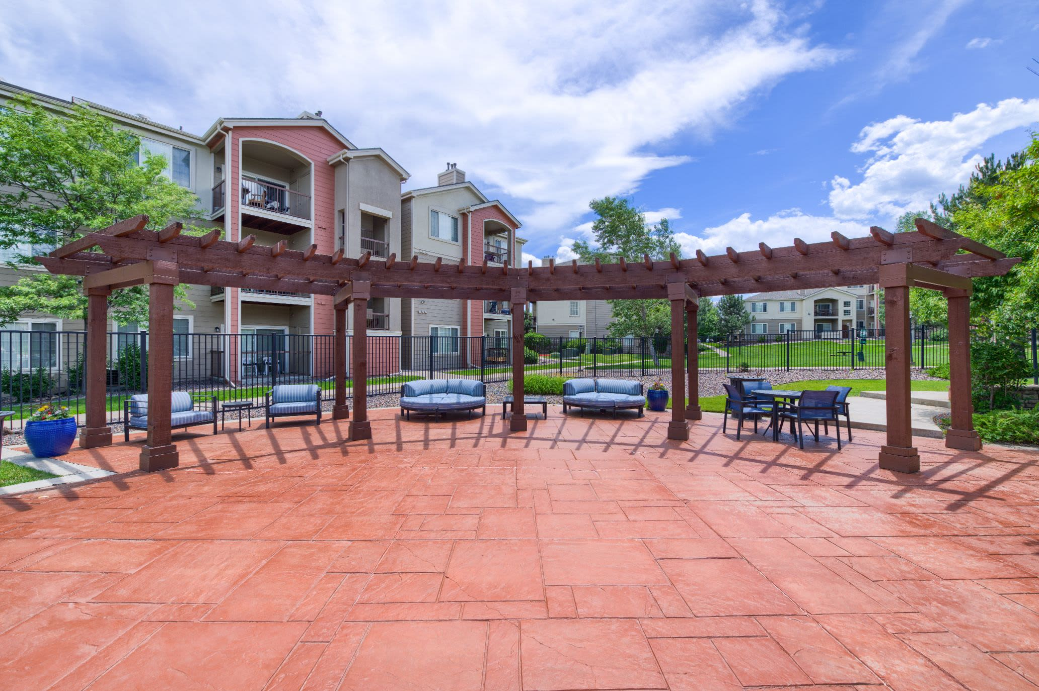 Sun chairs on large patio at Whisper Creek Apartment Homes in Lakewood, Colorado