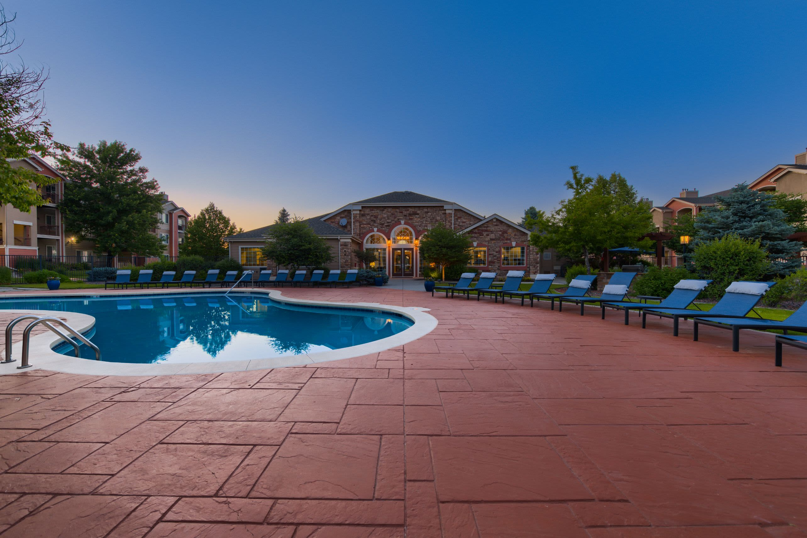 Swimming pool at twilight at Whisper Creek Apartment Homes in Lakewood, Colorado