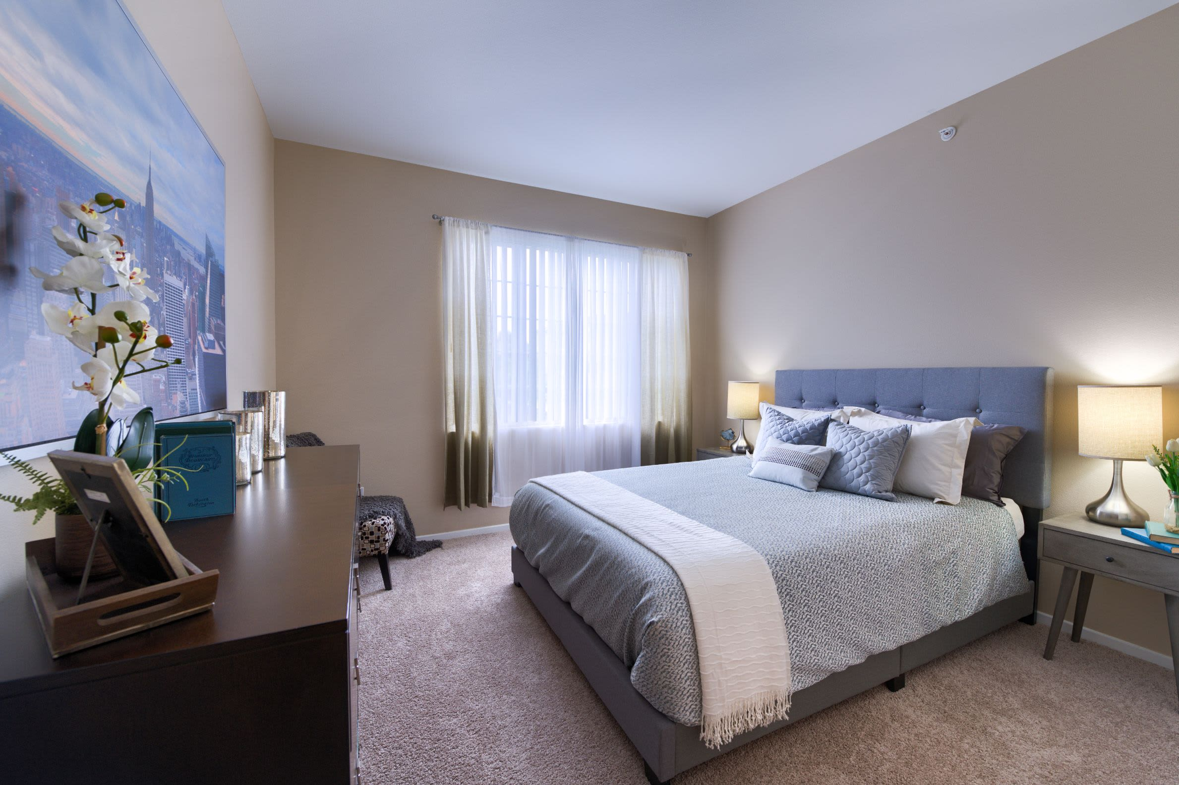 Bedroom with carpet flooring at Whisper Creek Apartment Homes in Lakewood, Colorado