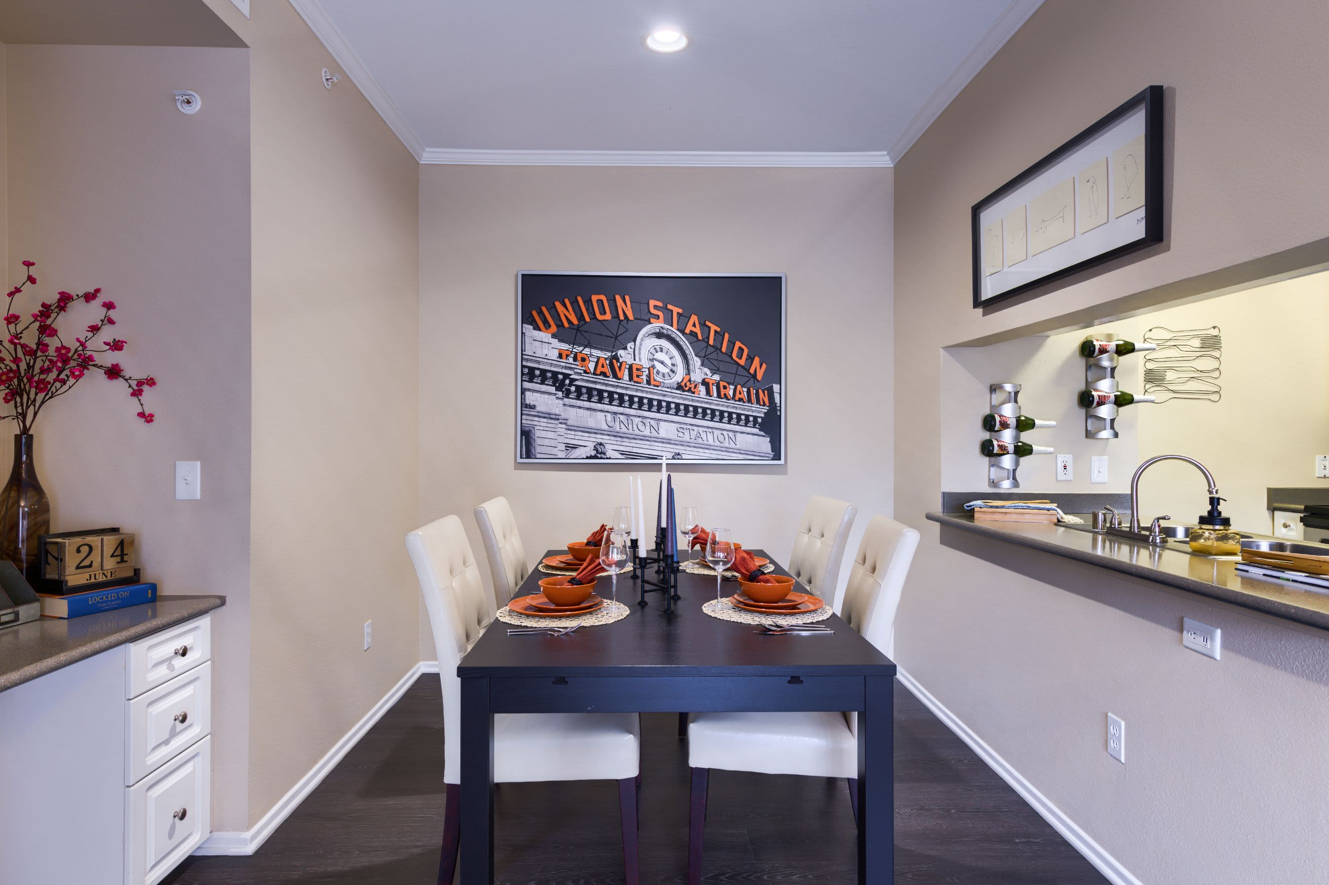 Dining room with neatly made table at Whisper Creek Apartment Homes in Lakewood, Colorado