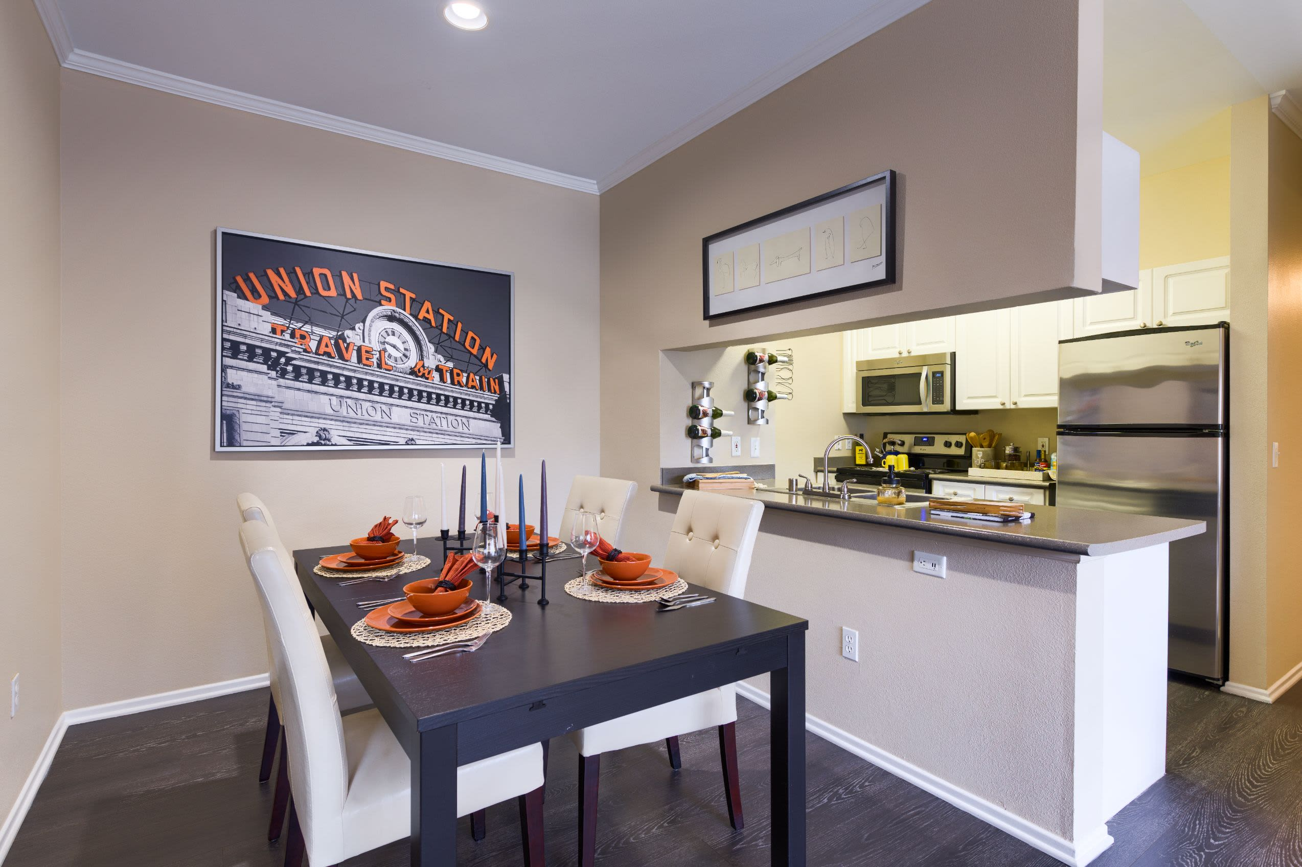 Dining room next to kitchen at Whisper Creek Apartment Homes in Lakewood, Colorado