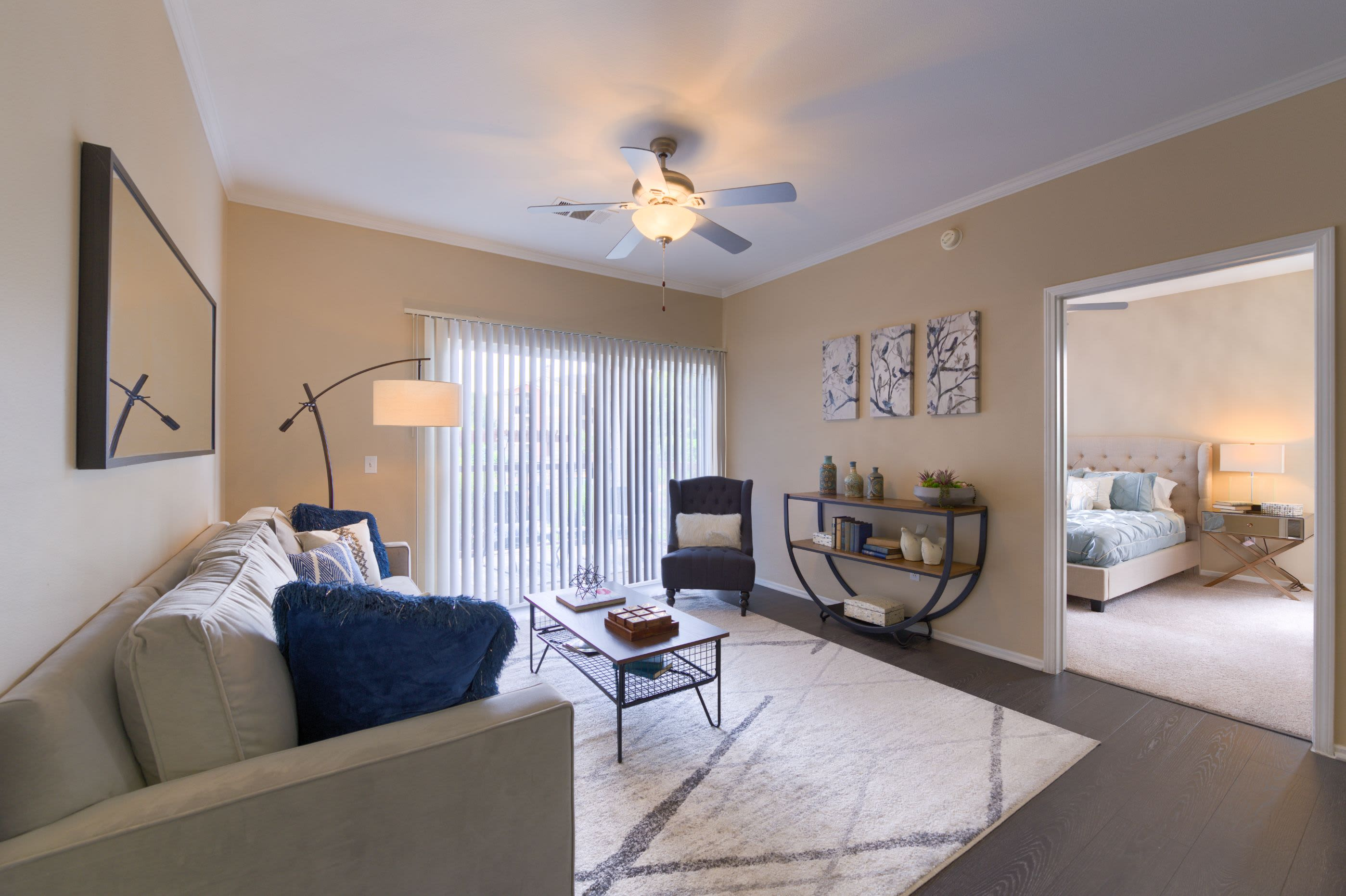 Living room with wood style floors at Whisper Creek Apartment Homes in Lakewood, Colorado