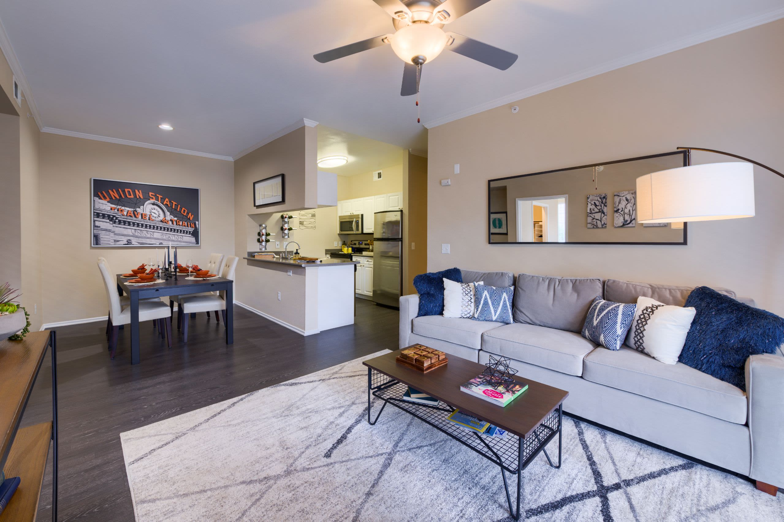 Well decorated living room at Whisper Creek Apartment Homes in Lakewood, Colorado