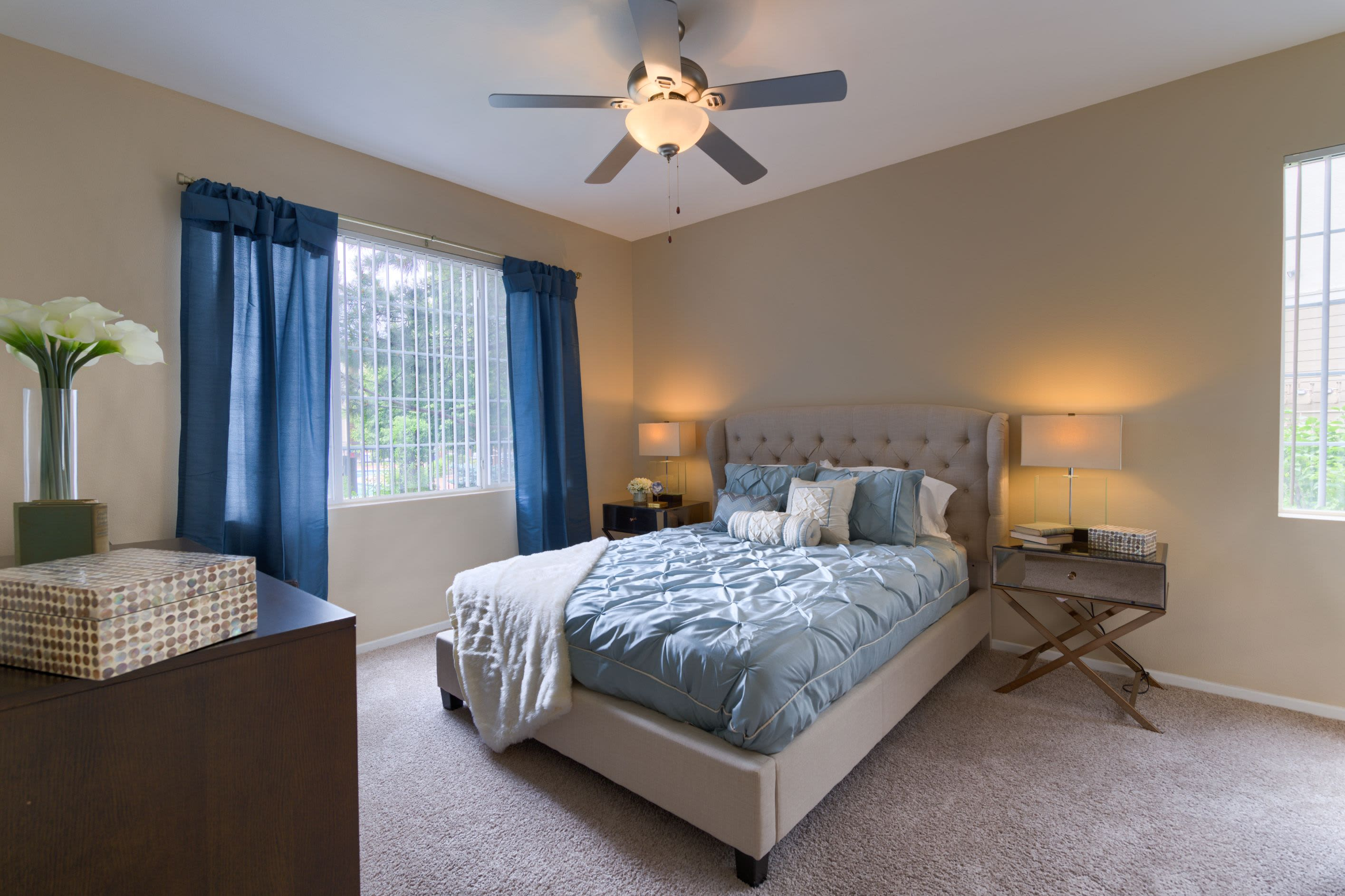 Bedroom with ceiling fan at Whisper Creek Apartment Homes in Lakewood, Colorado