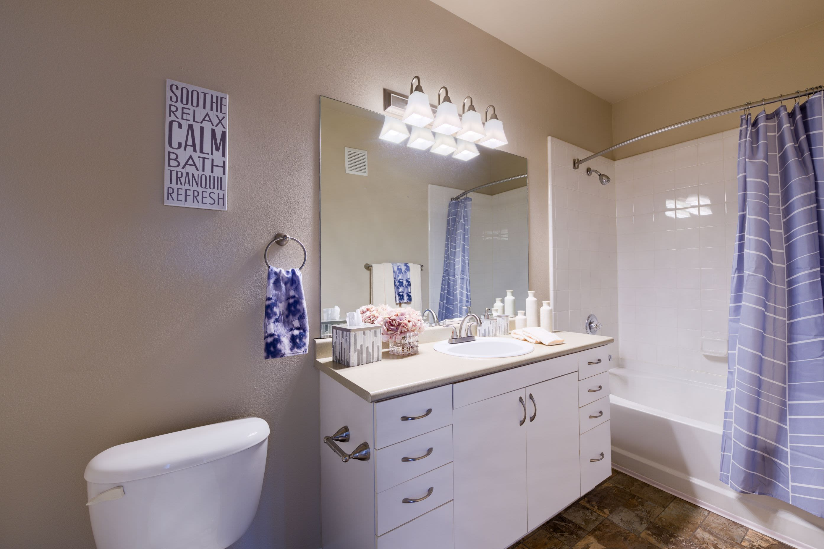Bathroom with wood style floors at Whisper Creek Apartment Homes in Lakewood, Colorado