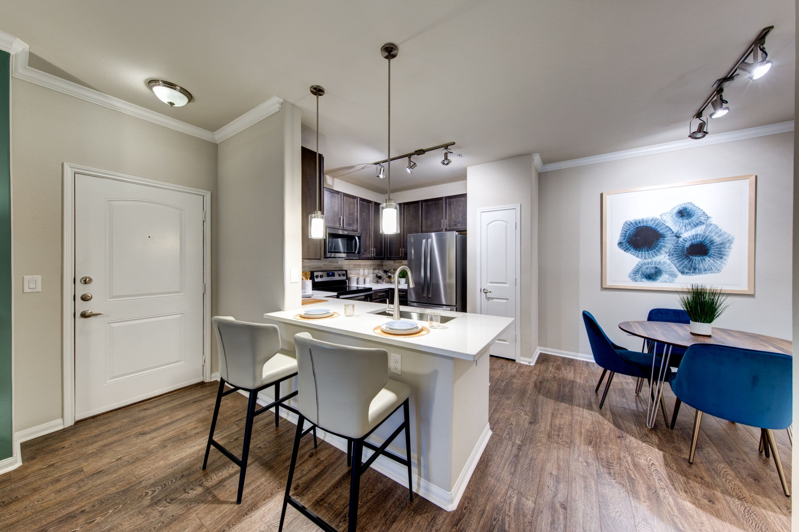 Kitchen with breakfast bar at Marquis at The Woodlands in Spring, Texas