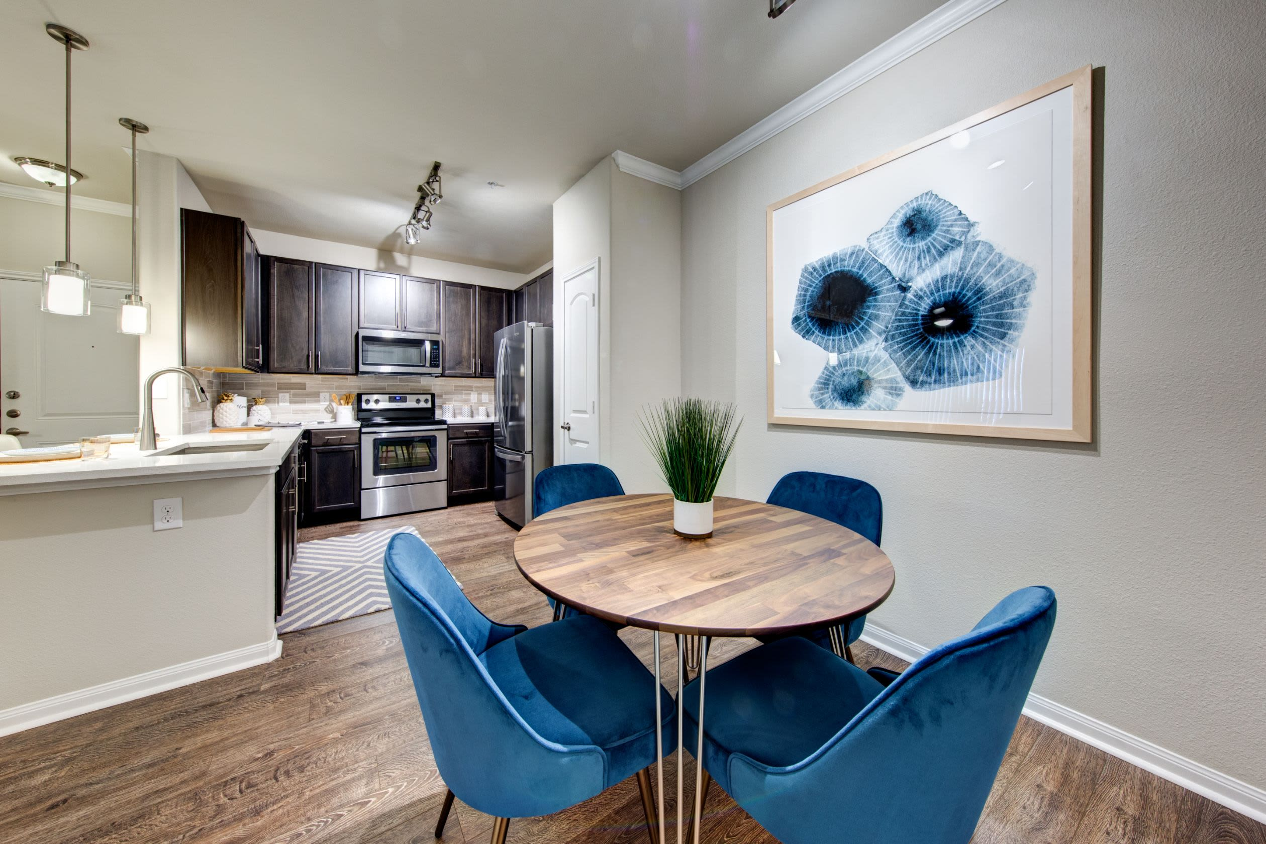 Dining area adjacent to the kitchen at Marquis at The Woodlands in Spring, Texas