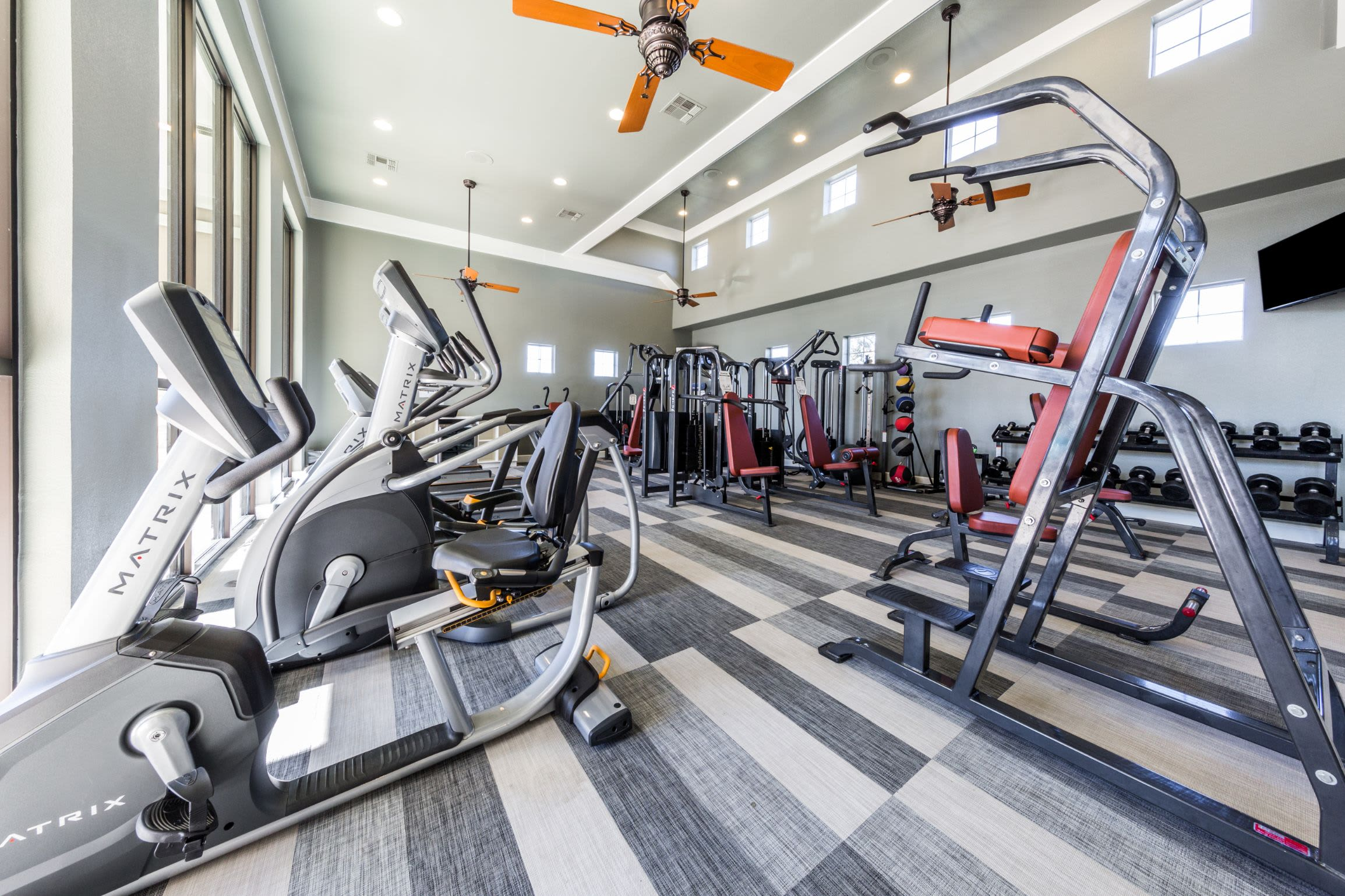 Fully equipped fitness center at Marquis at The Woodlands in Spring, Texas