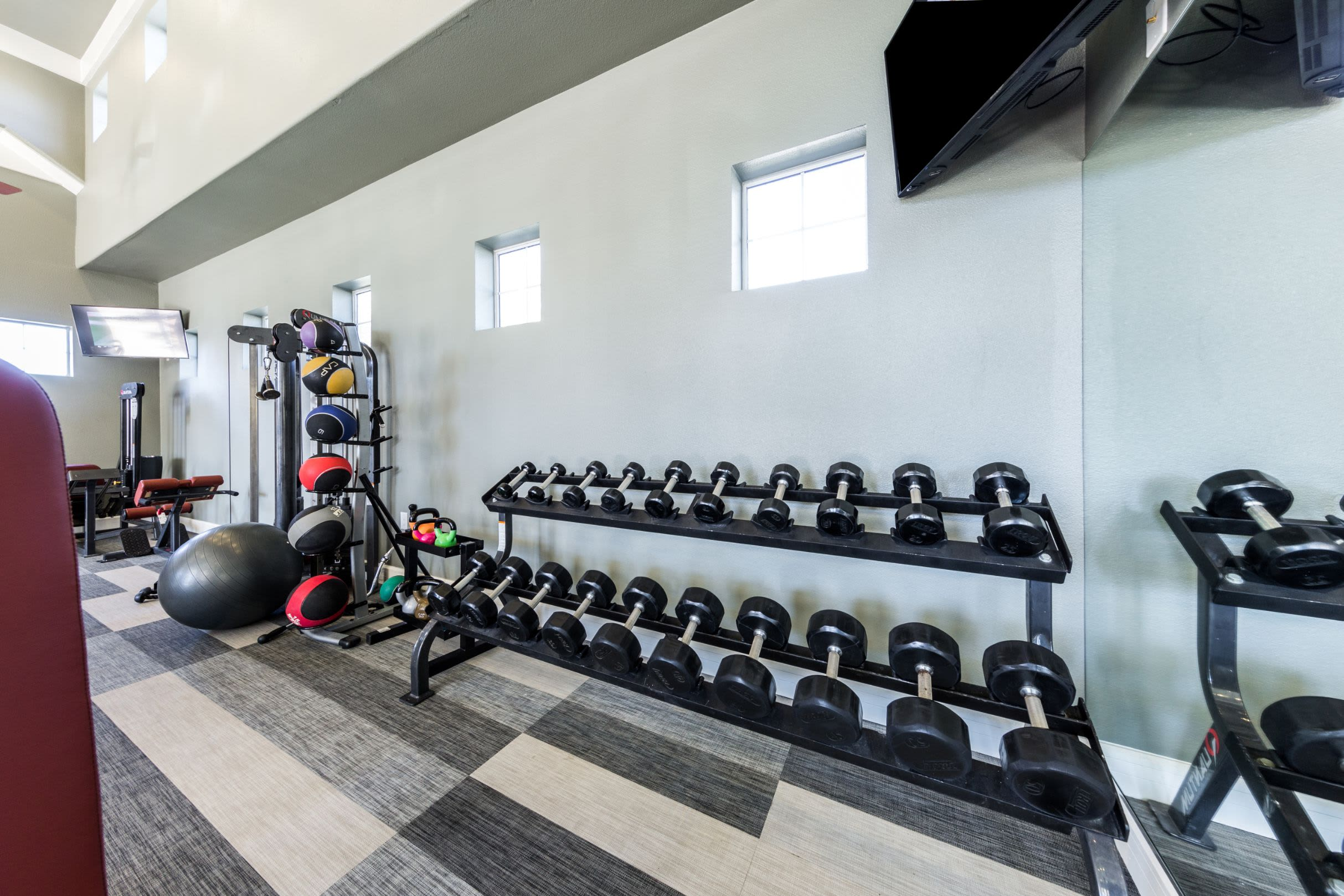 Rack of weights in fitness center at Marquis at The Woodlands in Spring, Texas