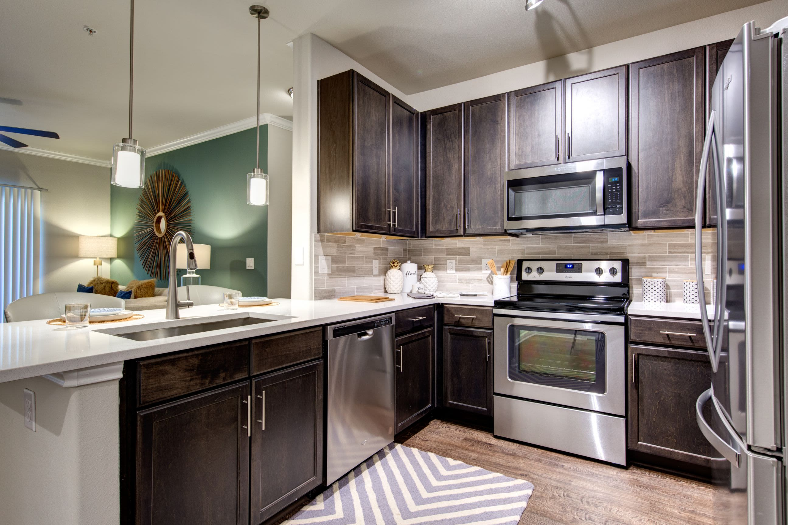 Kitchen with modern appliances at Marquis at The Woodlands in Spring, Texas