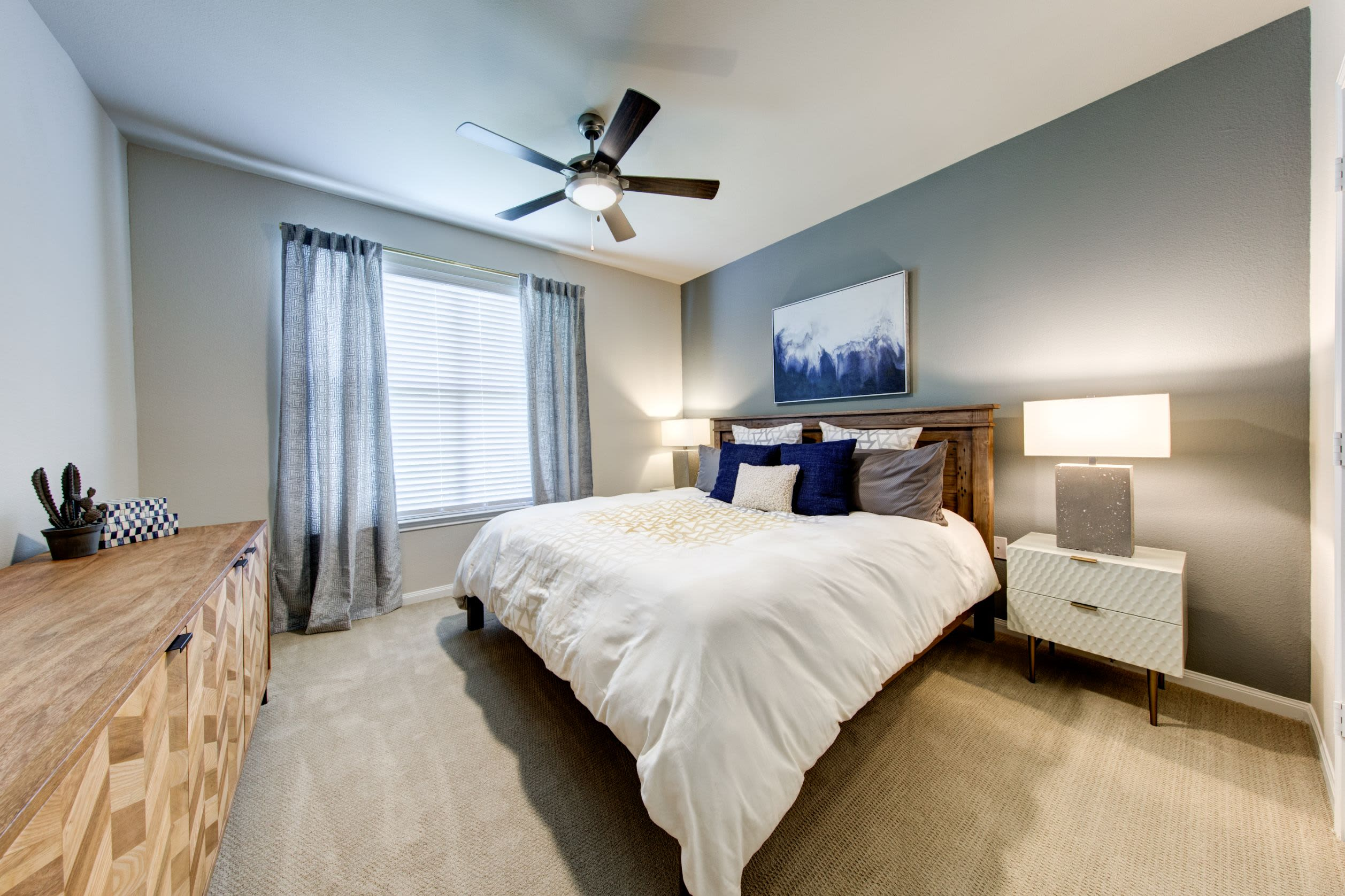 Bedroom with wood style flooring at Marquis at The Woodlands in Spring, Texas