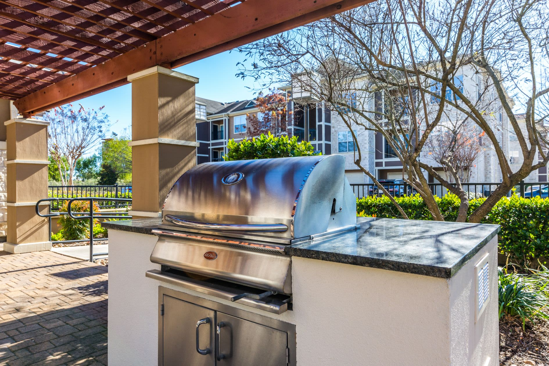 Outdoor grill for residents at Marquis at The Woodlands in Spring, Texas
