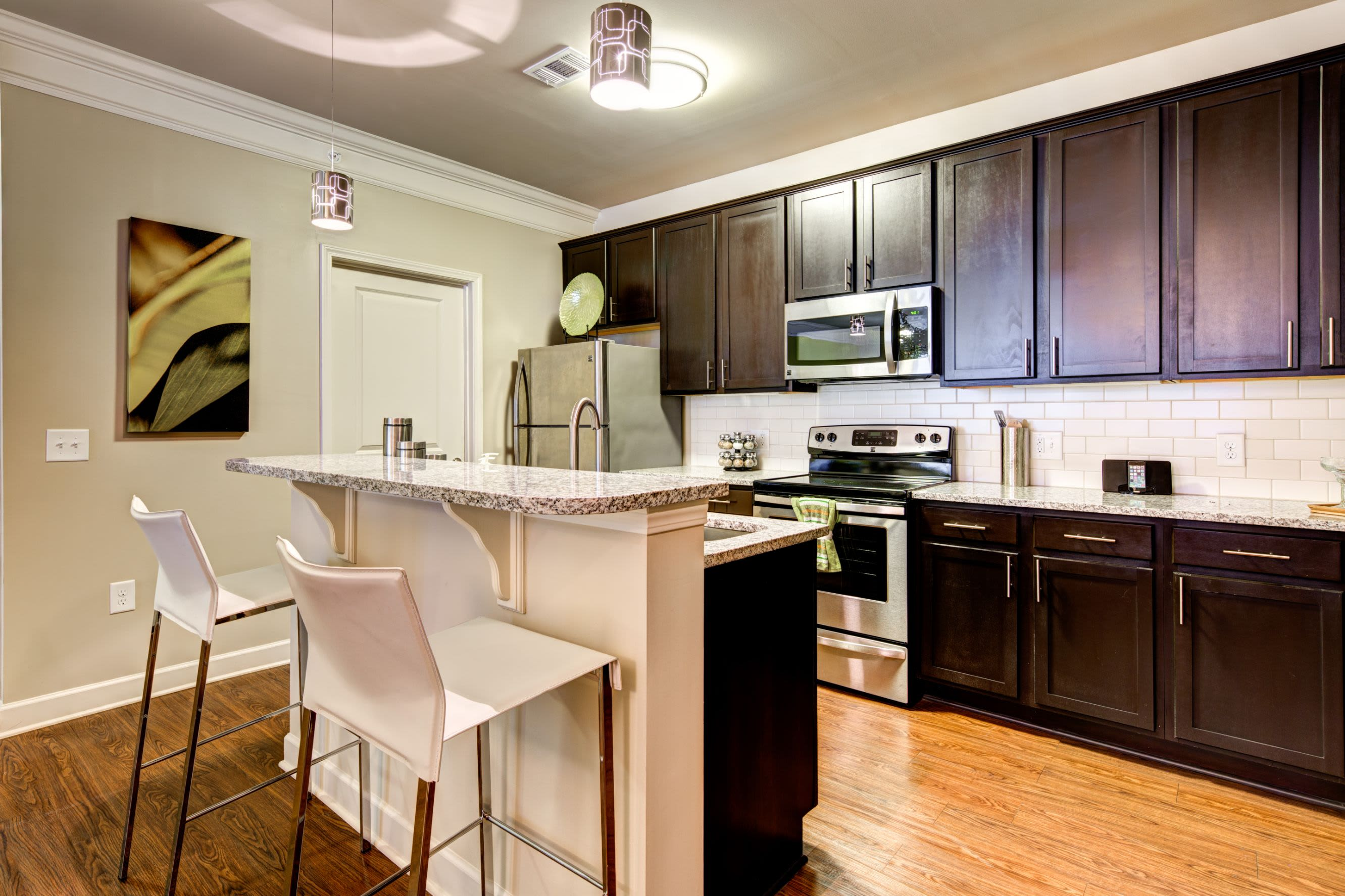 Modern kitchen with breakfast bar at Marquis at Morrison Plantation in Mooresville, North Carolina