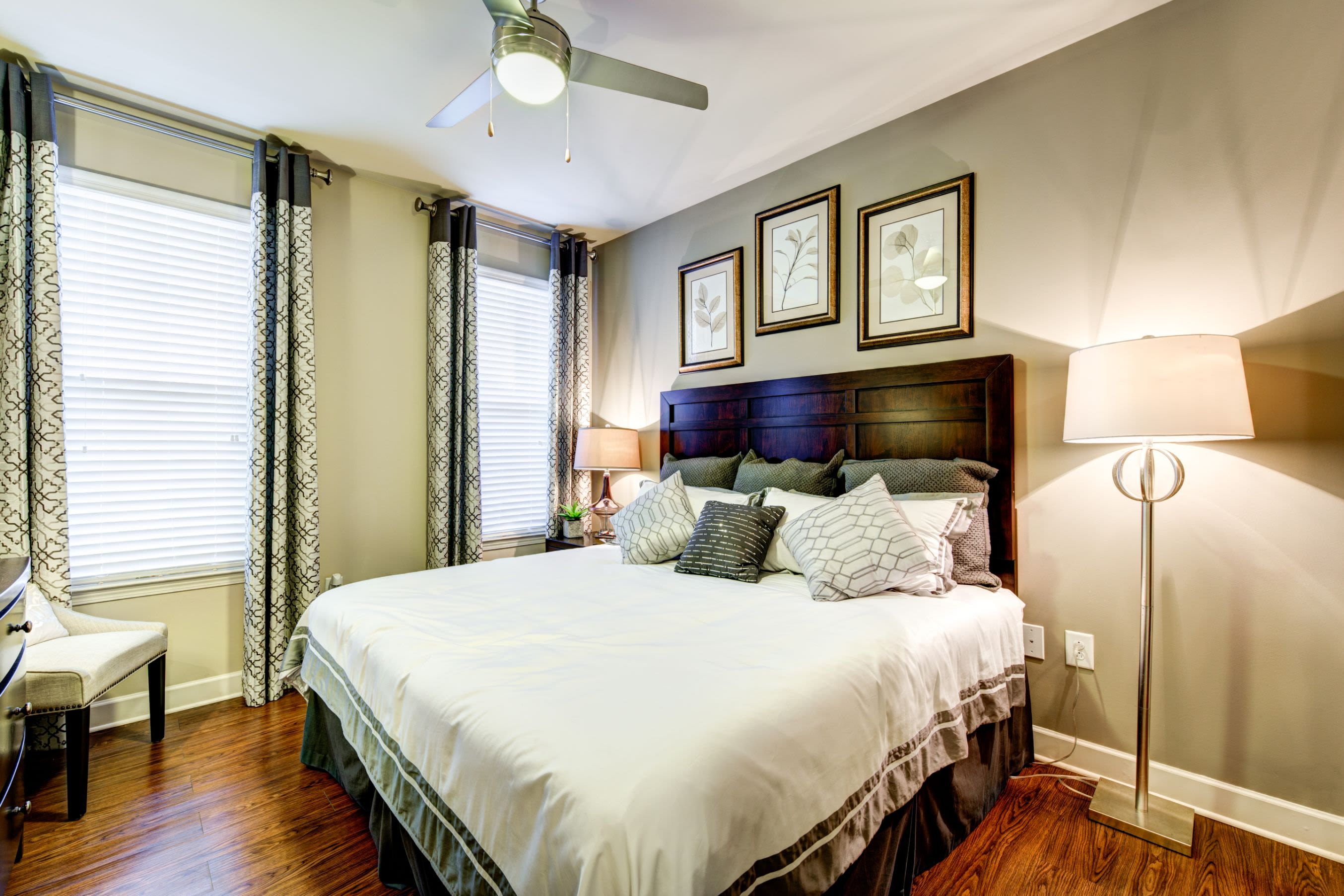 Bright bedroom with large windows at Marquis at Morrison Plantation in Mooresville, North Carolina