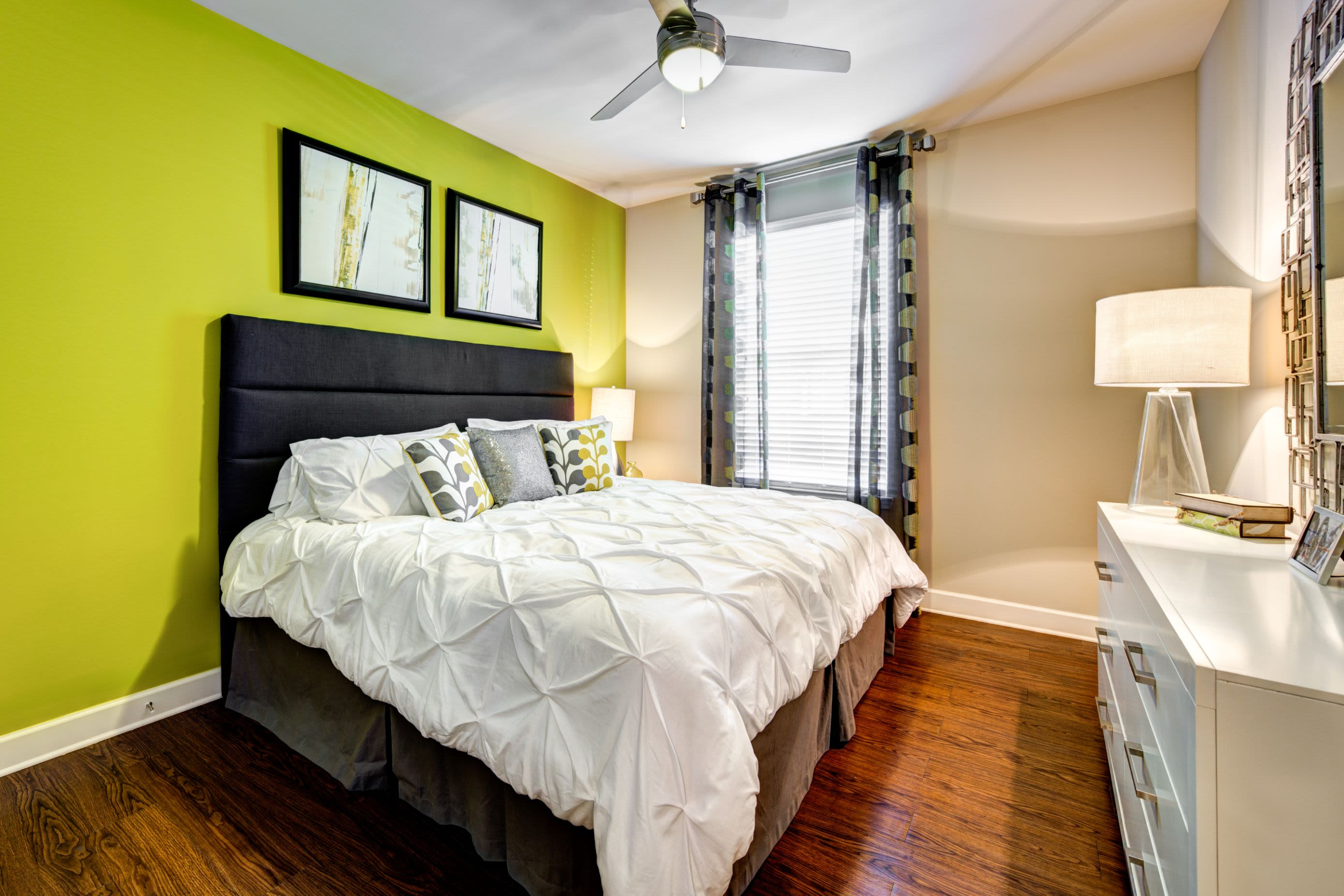 Bedroom with wood style flooring at Marquis at Morrison Plantation in Mooresville, North Carolina
