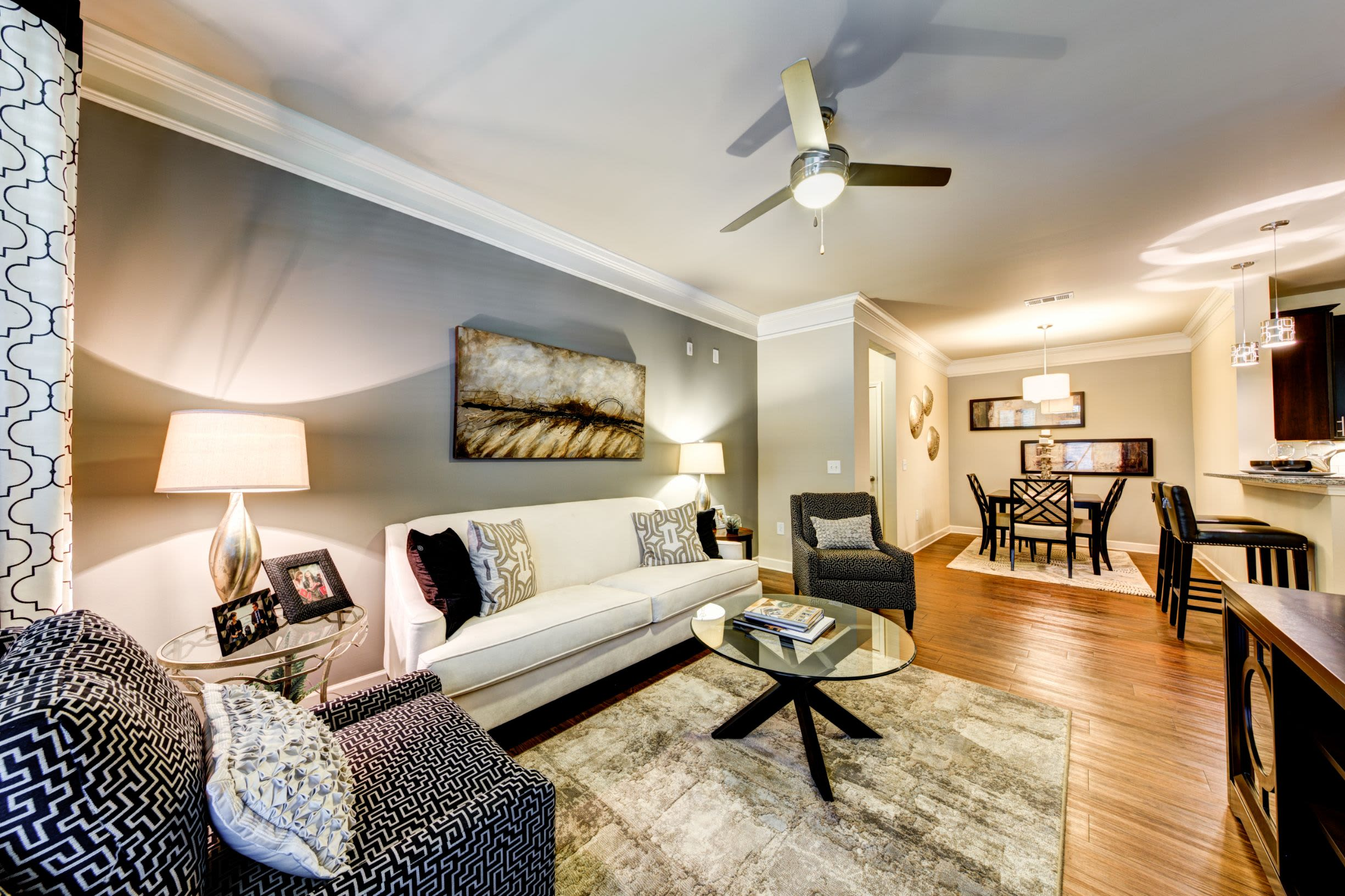 Living room with wood style floors at Marquis at Morrison Plantation in Mooresville, North Carolina