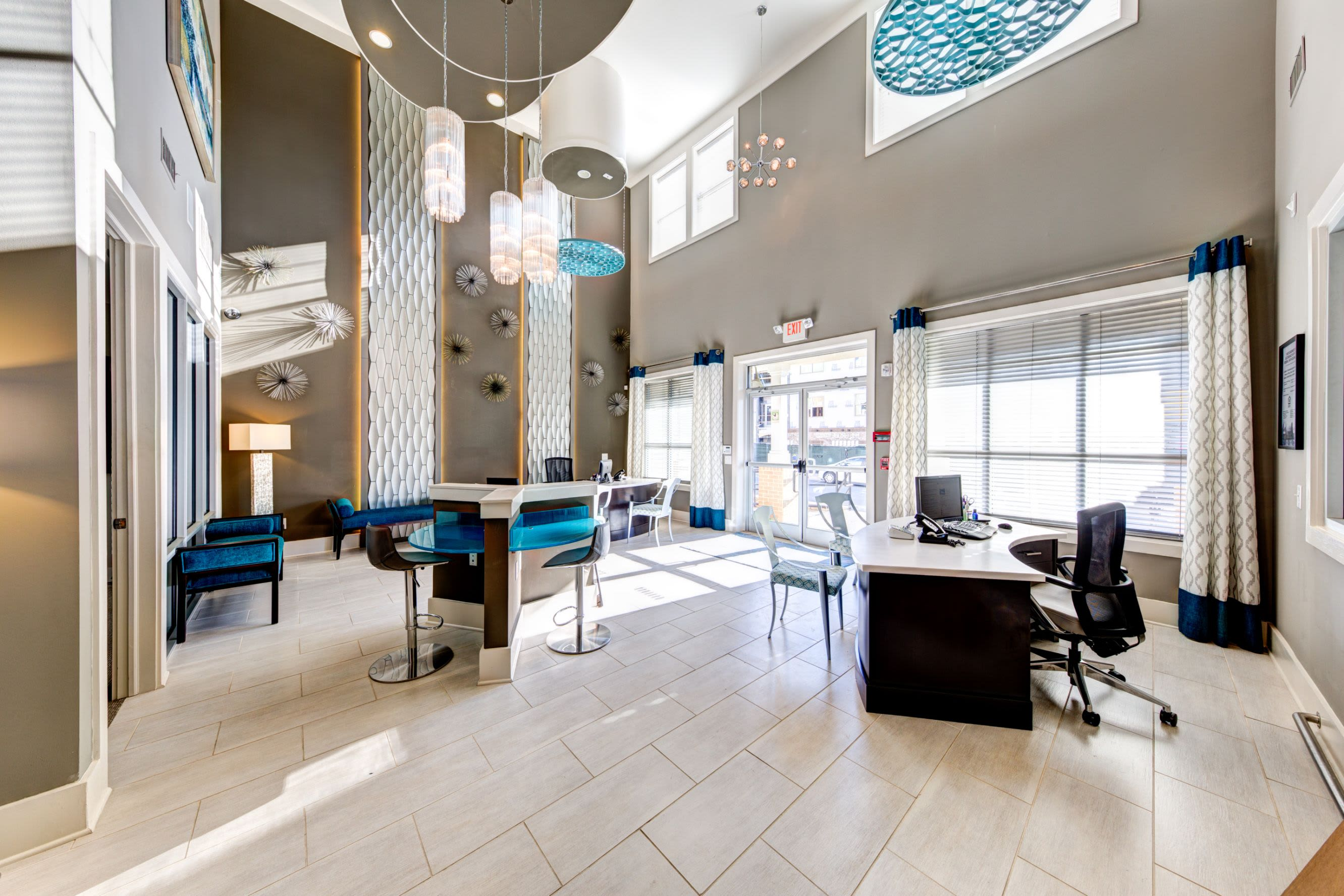 Lobby with large windows at Marquis at Morrison Plantation in Mooresville, North Carolina