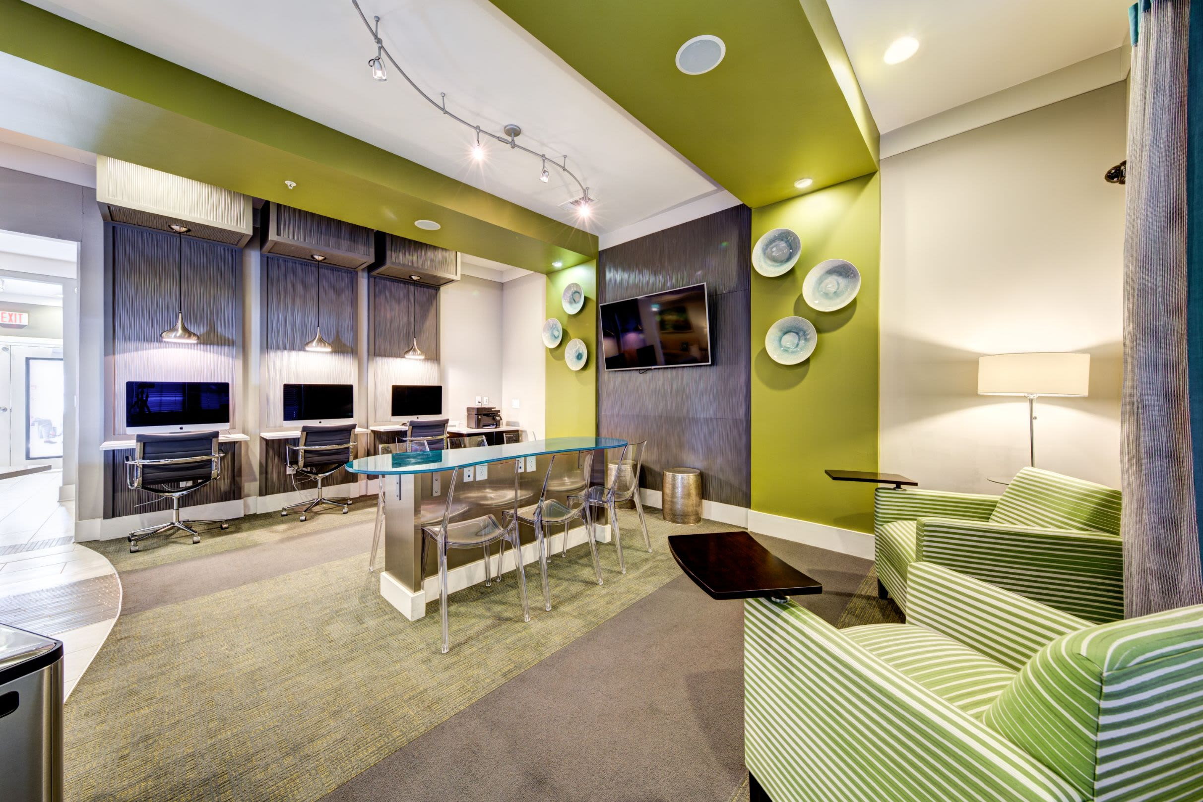 Business center with TV at Marquis at Morrison Plantation in Mooresville, North Carolina