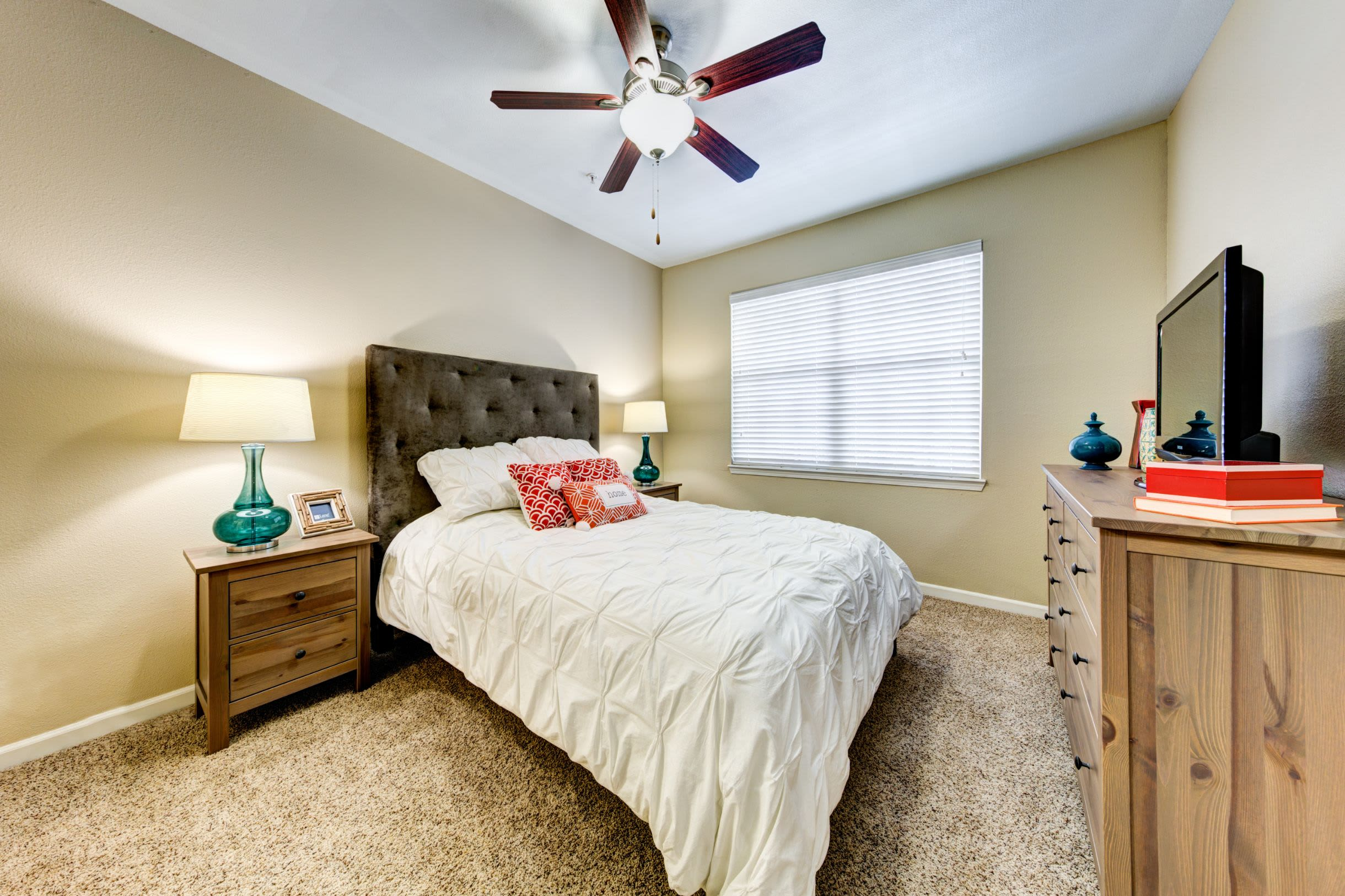 Bedroom with a ceiling fan at Marquis at Town Centre in Broomfield, Colorado