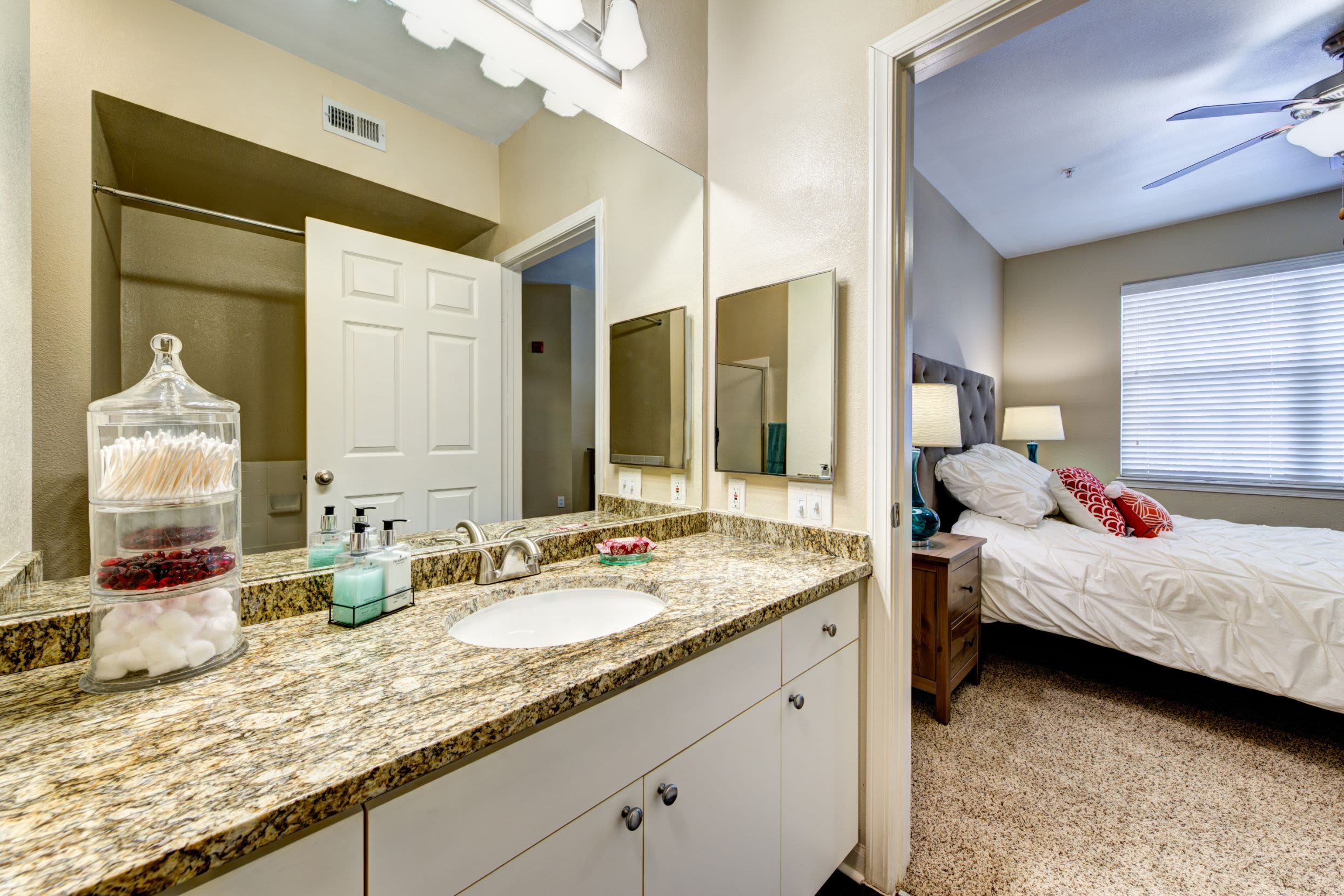 Bathroom with white cabinets at Marquis at Town Centre in Broomfield, Colorado