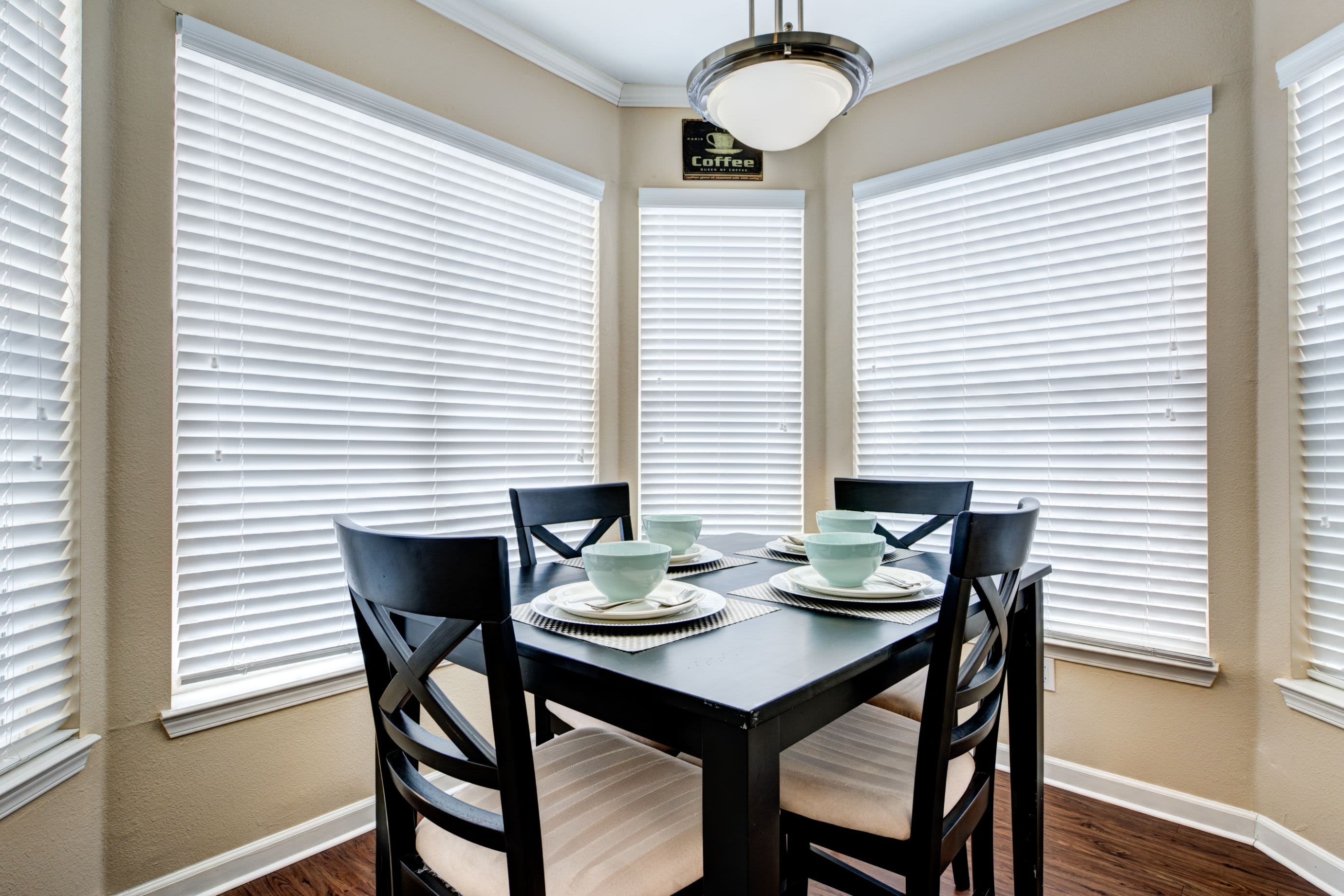 Dining area with large windows at Marquis at Town Centre in Broomfield, Colorado