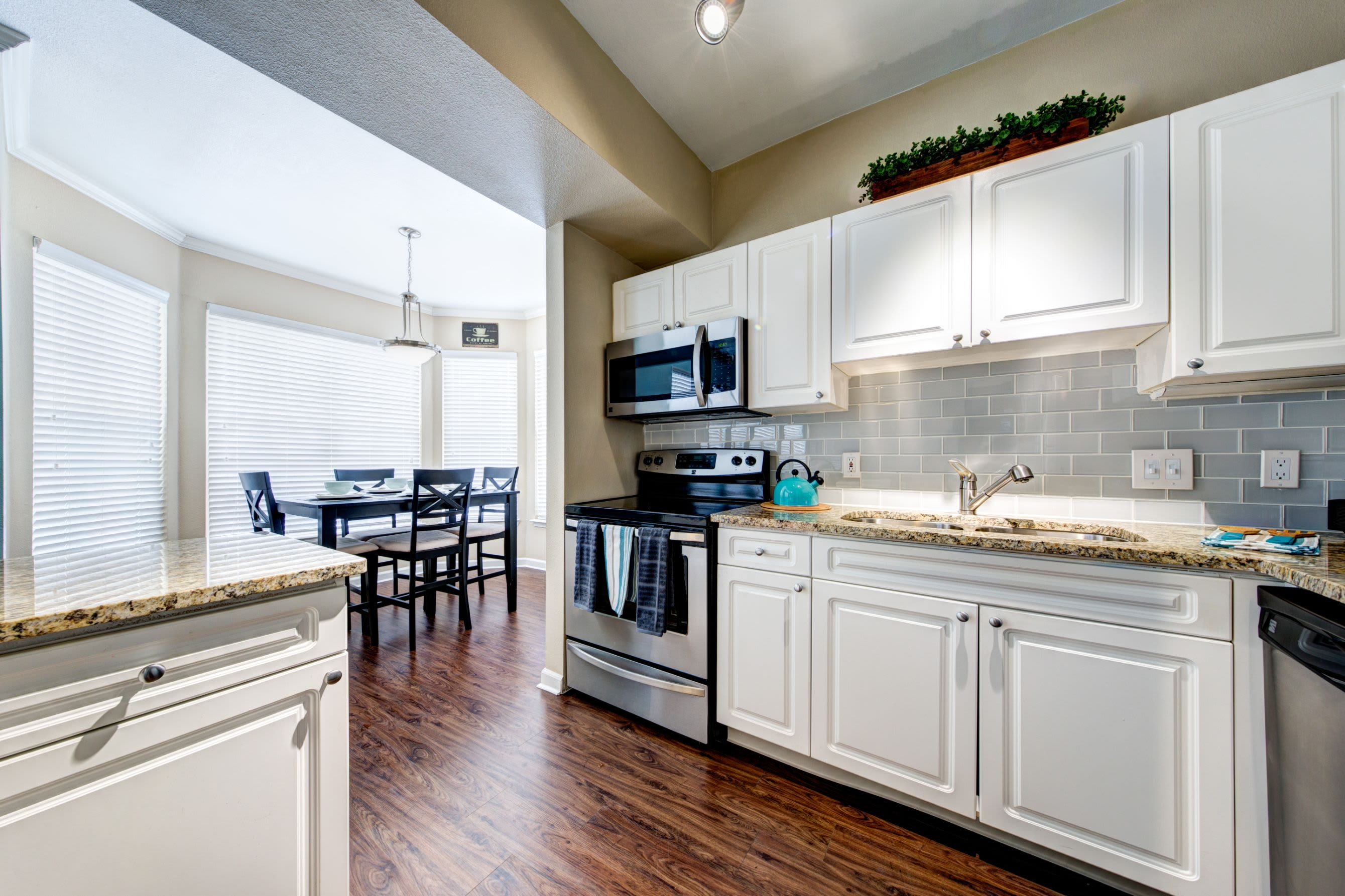 Modern kitchen with white cabinets at Marquis at Town Centre in Broomfield, Colorado