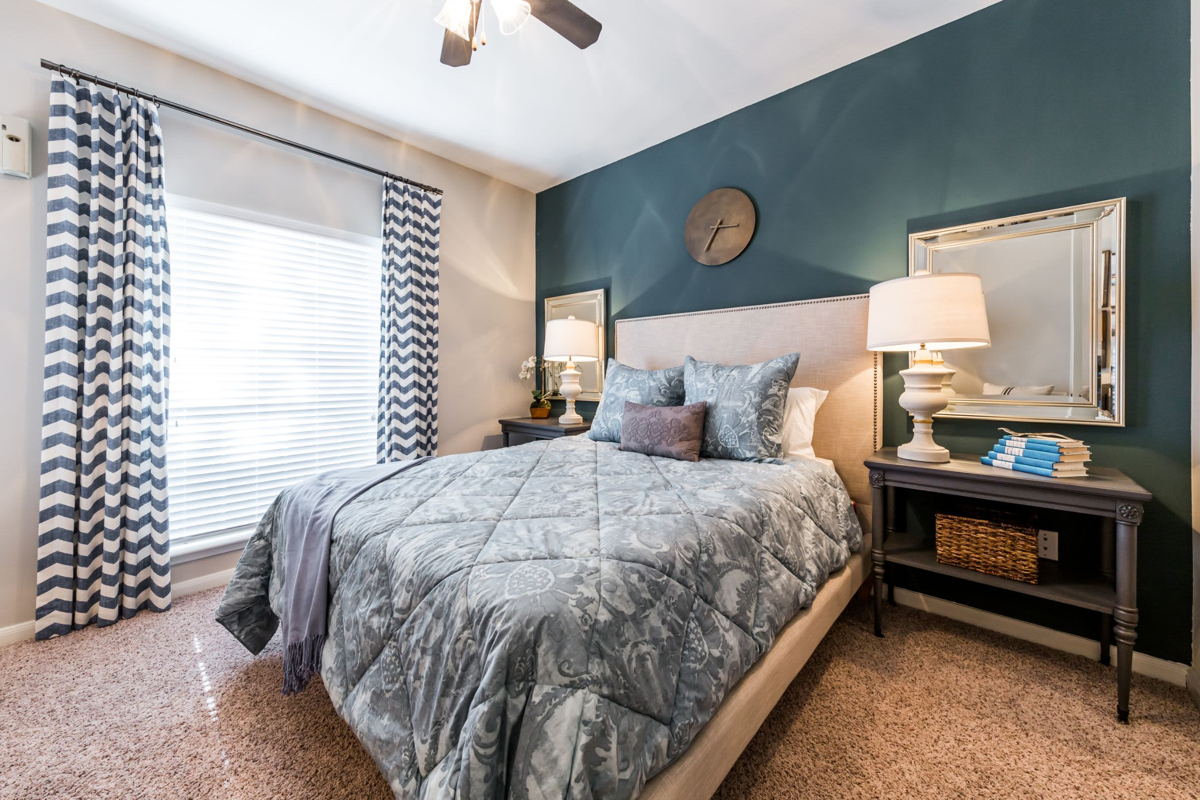 Bedroom with a large window at Marquis on Westheimer in Houston, Texas