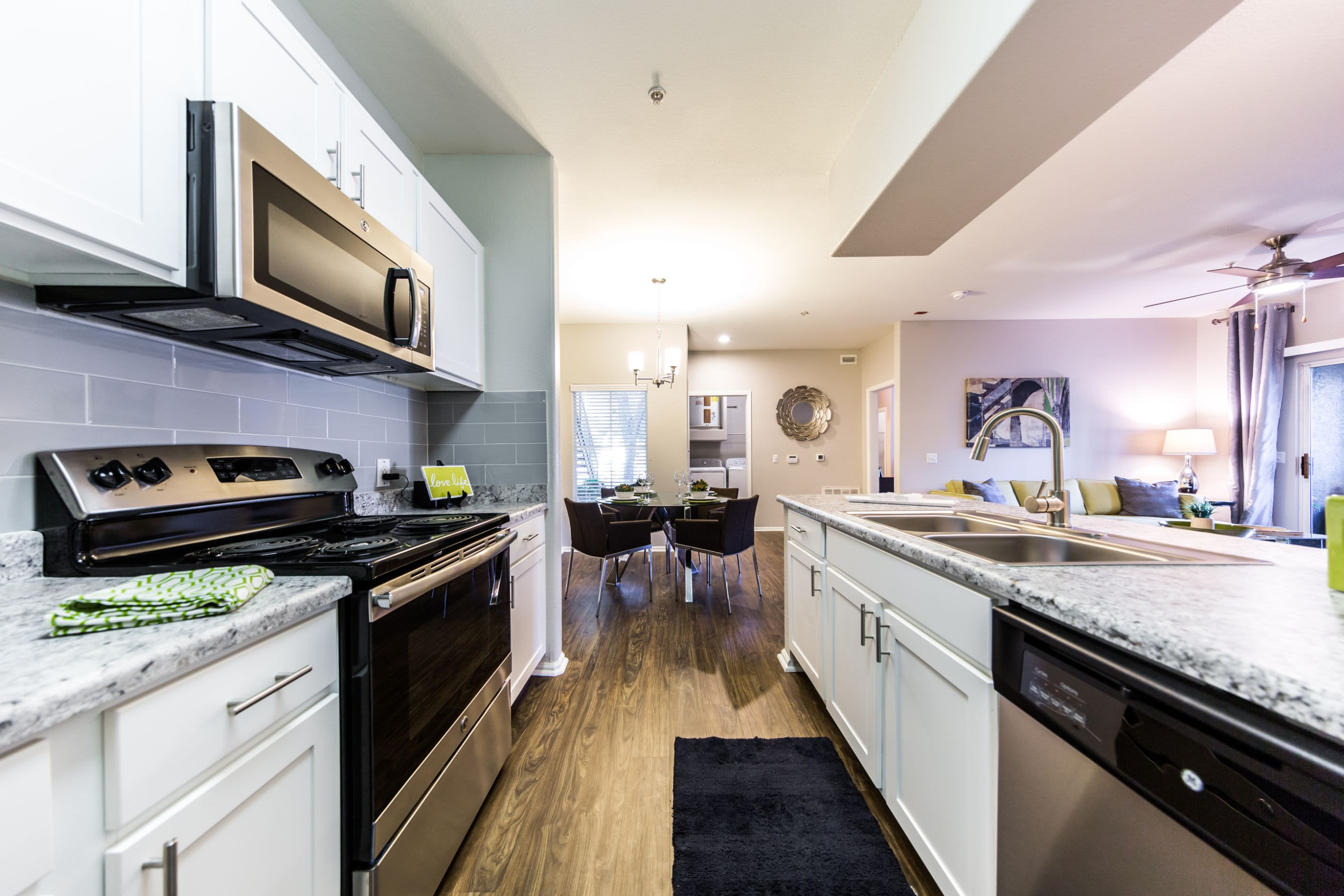 Kitchen with white cabinets at Marquis at Arrowhead in Peoria, Arizona